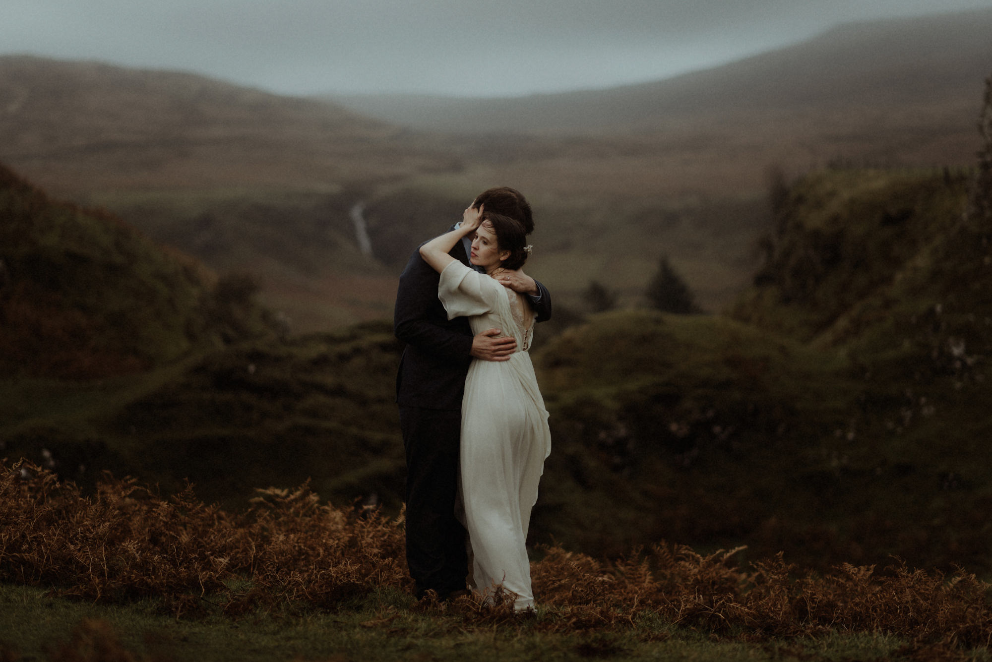 Gorgeous portrait of couple embracing overlooking glen by the Kitcheners - Scotland