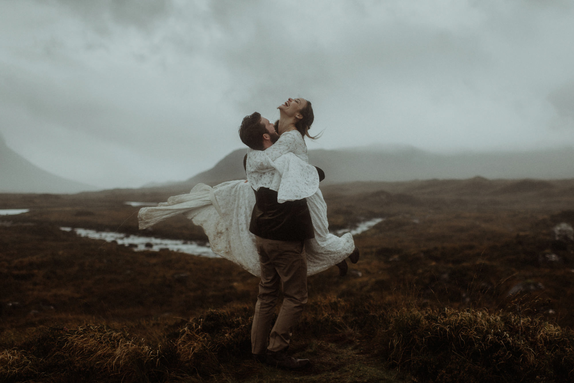 Estatic couple on Scottish moor by the Kitcheners - Scotland