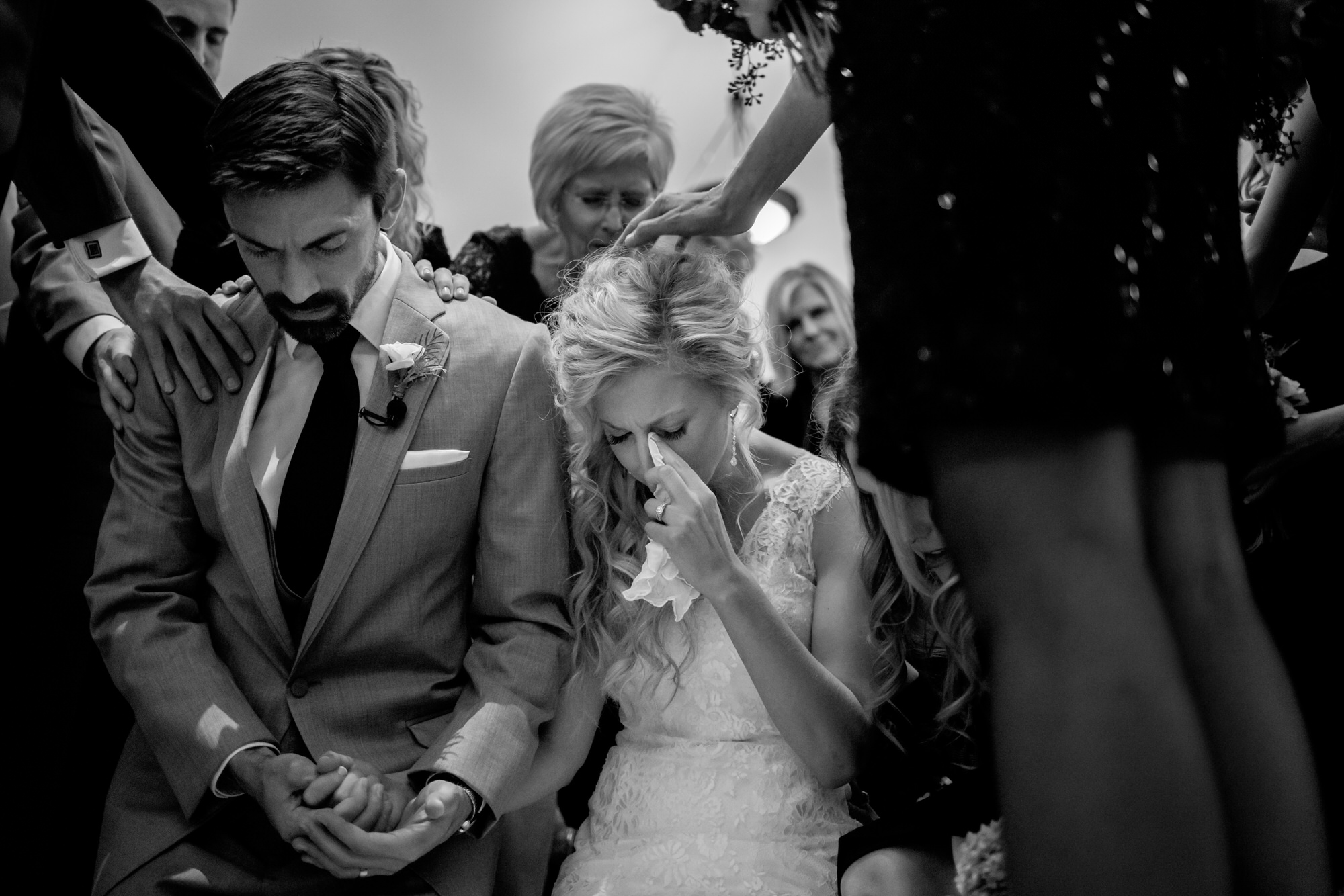 Emotional couple at prayer with guests - photo by Wirken Photography