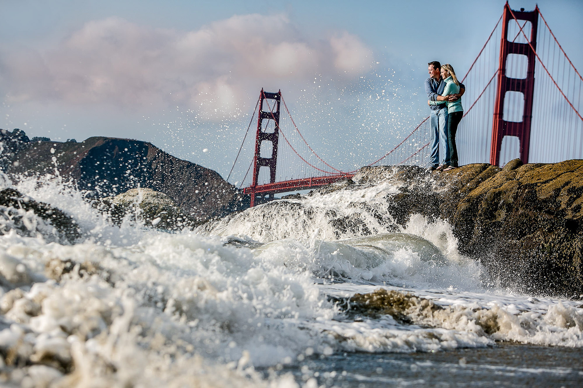 Engaged couple at Golden Gate Bridge by JOS Studios