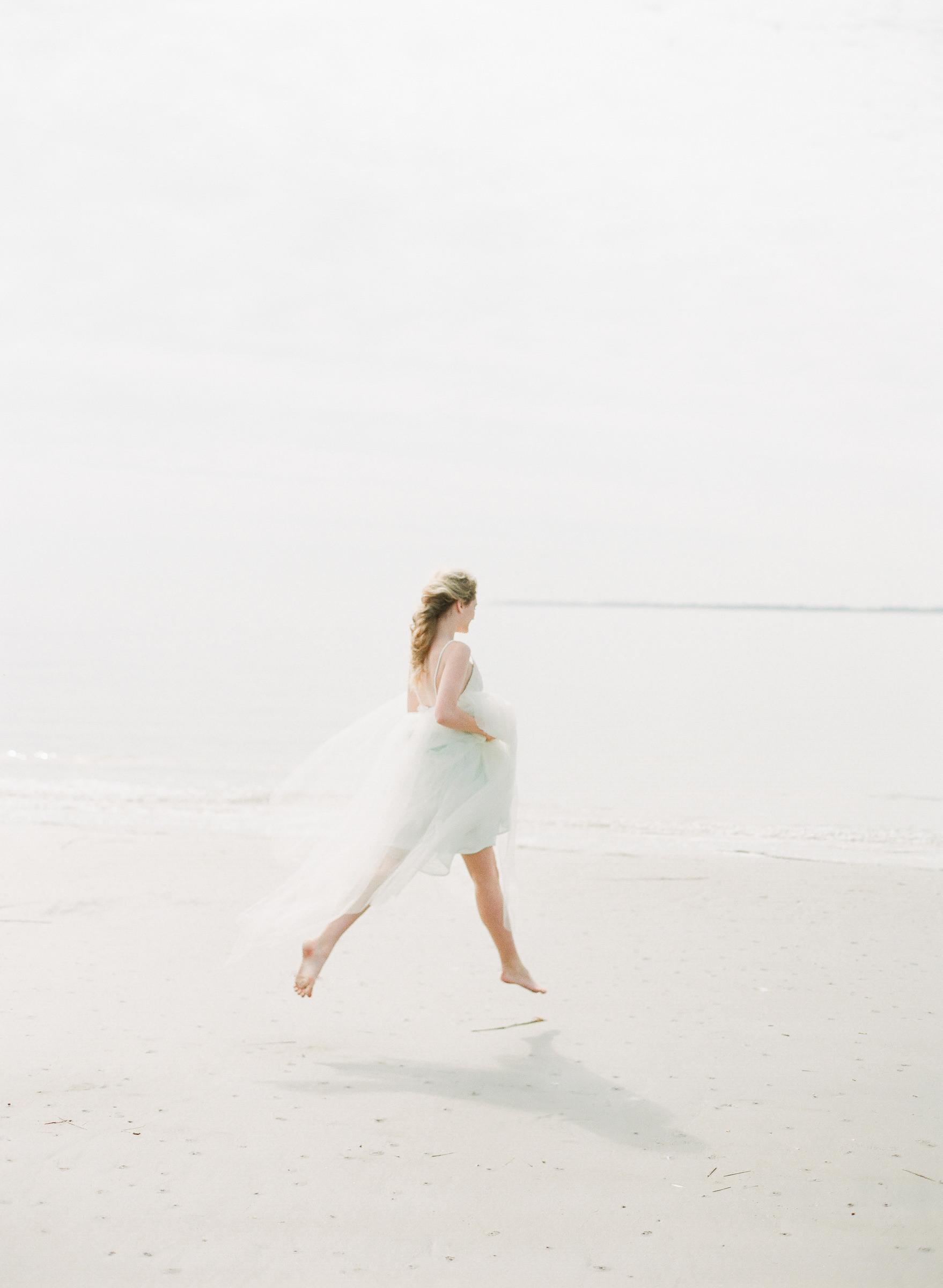 Ethereal photo of bride running on beach - photo by Corbin Gurkin