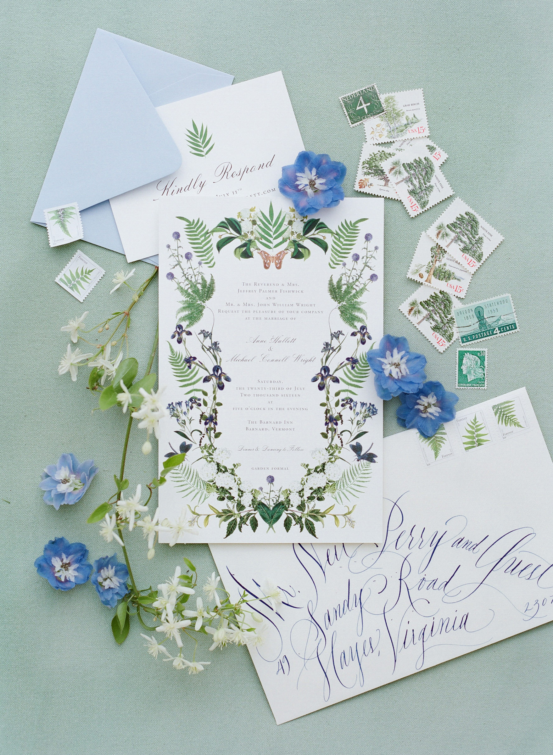 Floral and fern wedding invitations with blue envelopes - photo by Corbin Gurkin