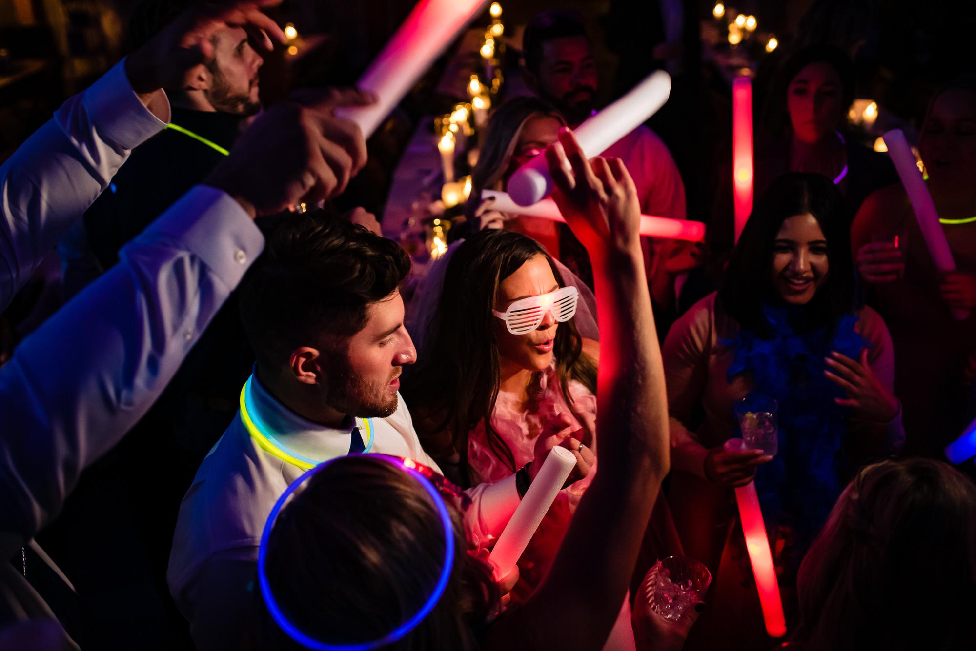 Fun reception party moment by Tyler Wirken