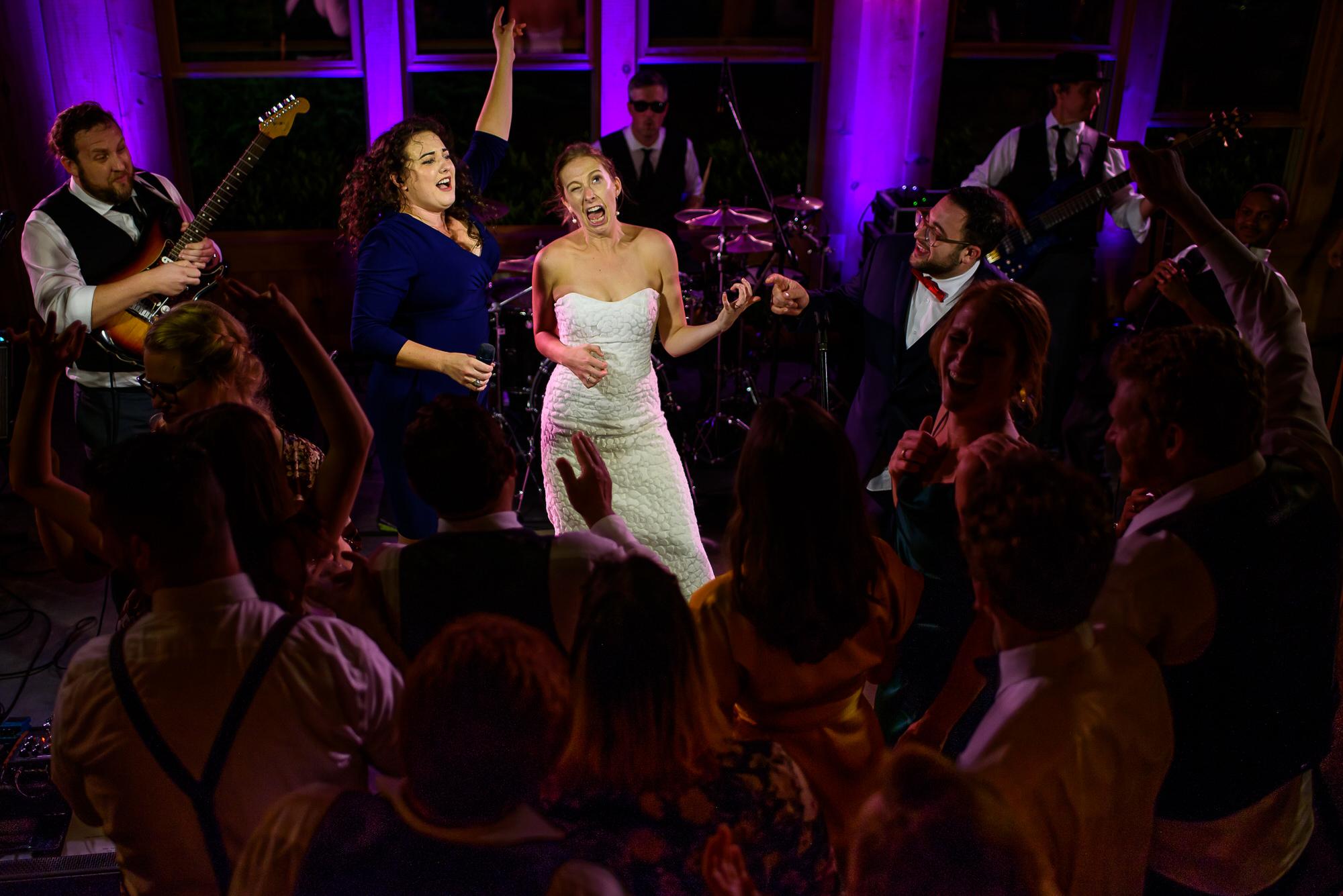 Bride making funny face on dance floor - photo by Tyler Wirken