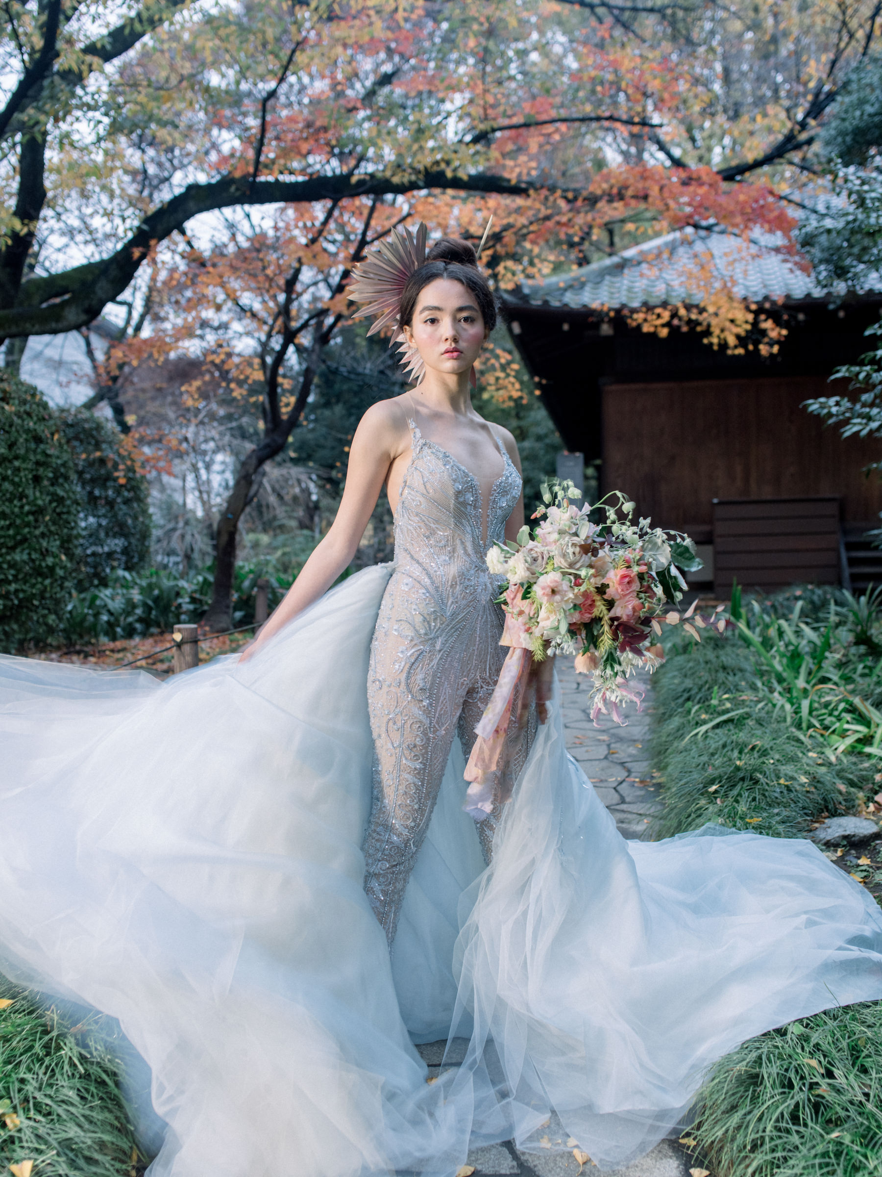 Bride in stunning metallic lace body suit and tulle train  - photo by Corbin Gurkin