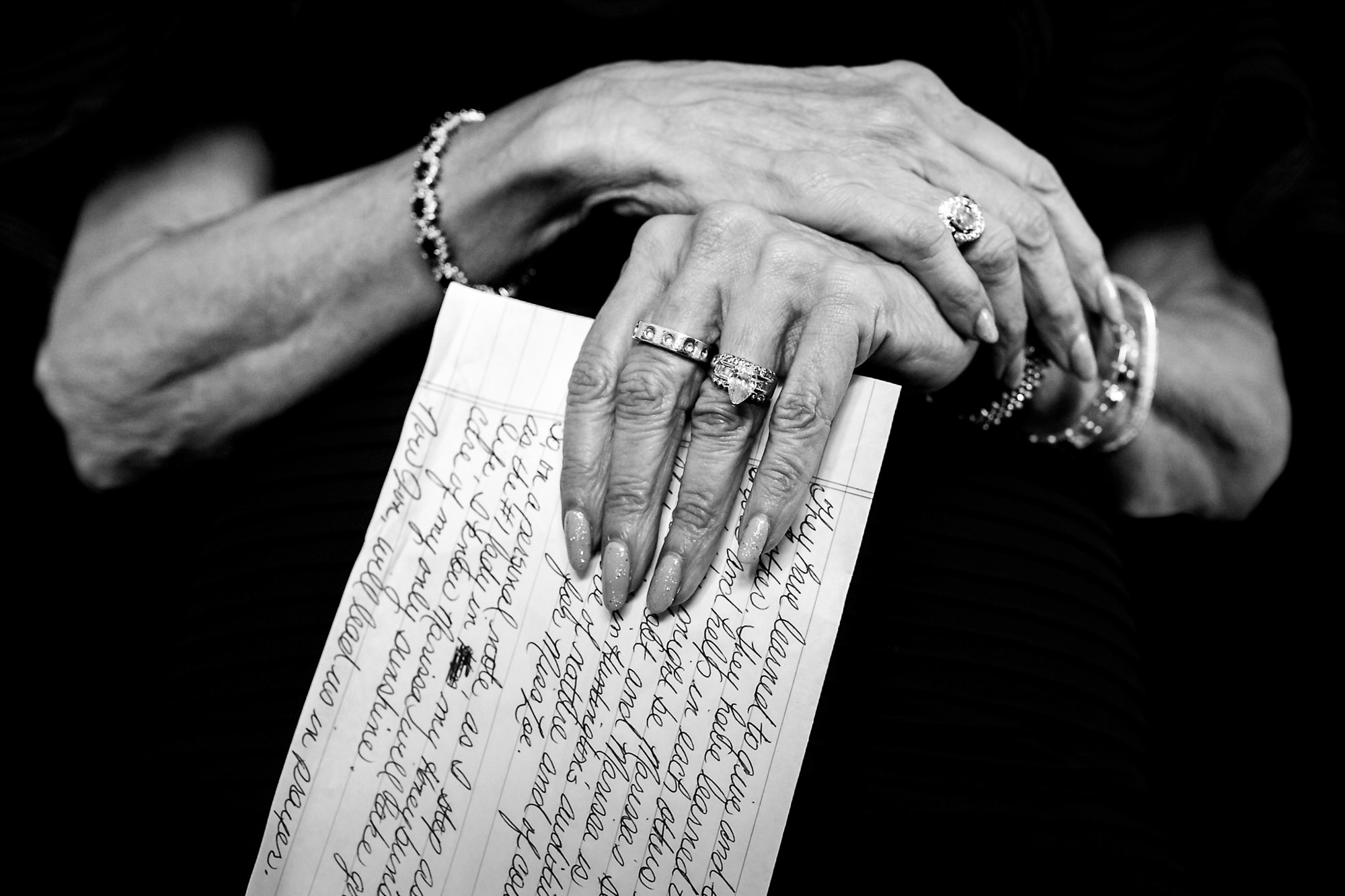 Grandmother's hands holding letter - photo by Two Mann Studios