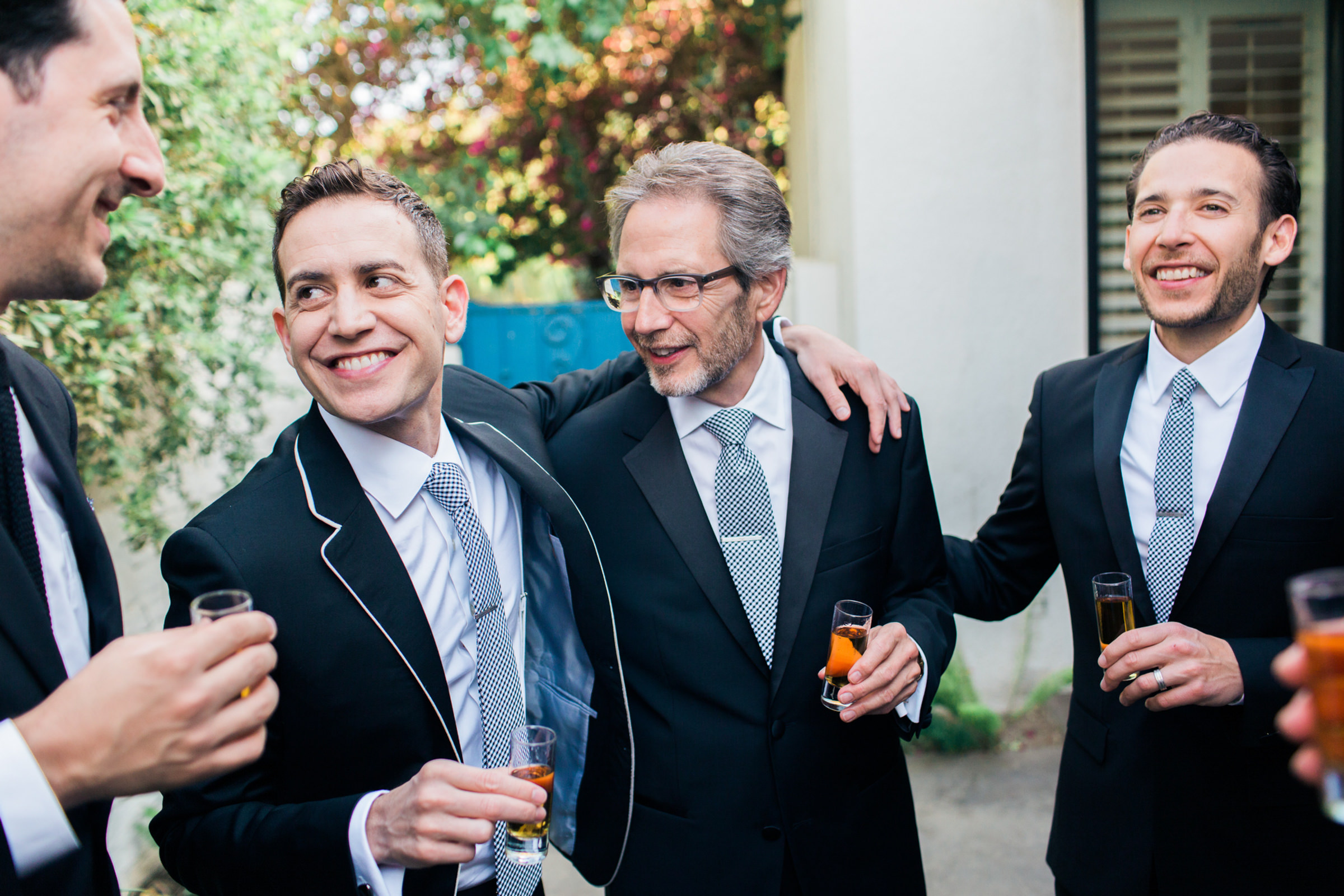 Candid portrait of groomsmen and family  -  photo by Corbin Gurkin