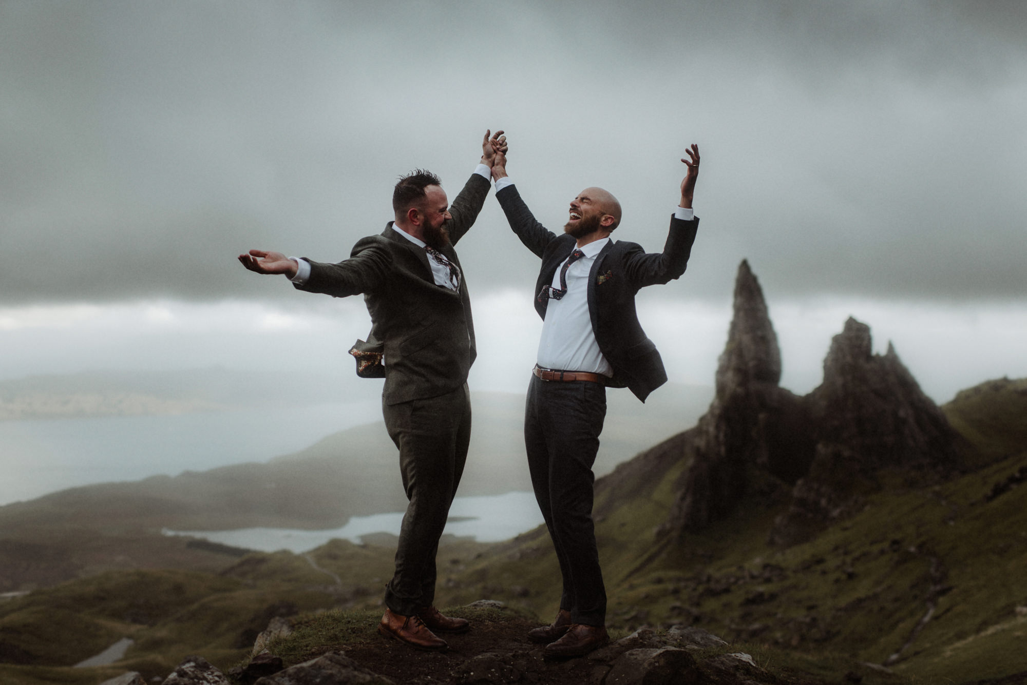 Grooms celebrating on mountain above the moors by The Kitcheners