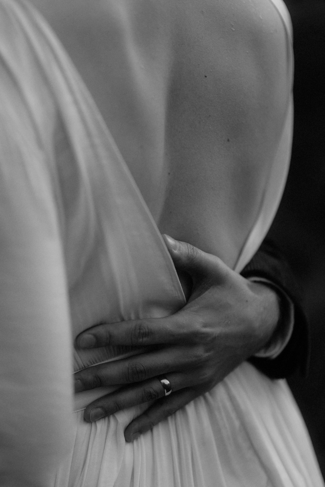 Groom's hand caress brides back - photo by the Kitcheners - Scotland