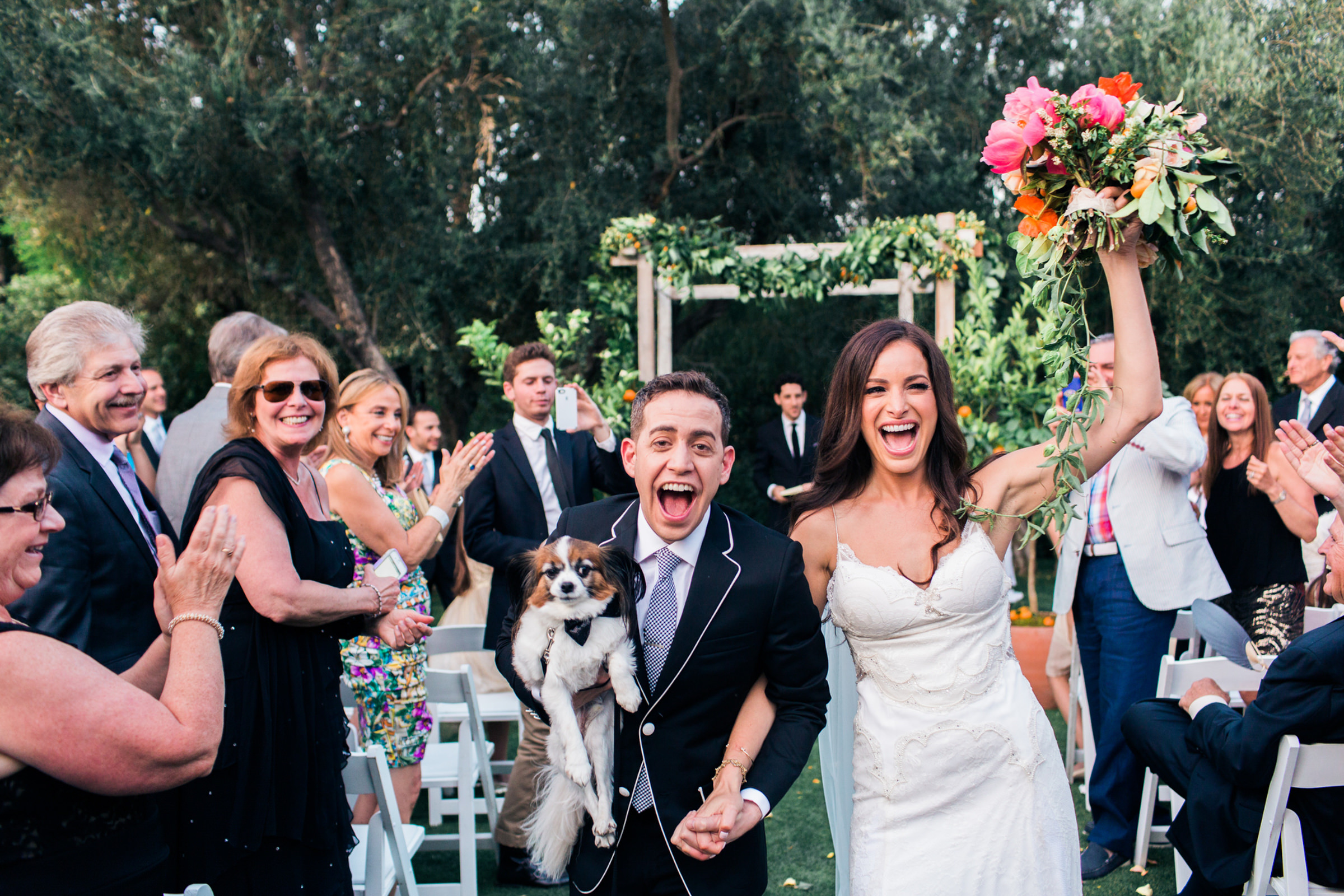 Happy couple processional with puppy - photo by Corbin Gurkin