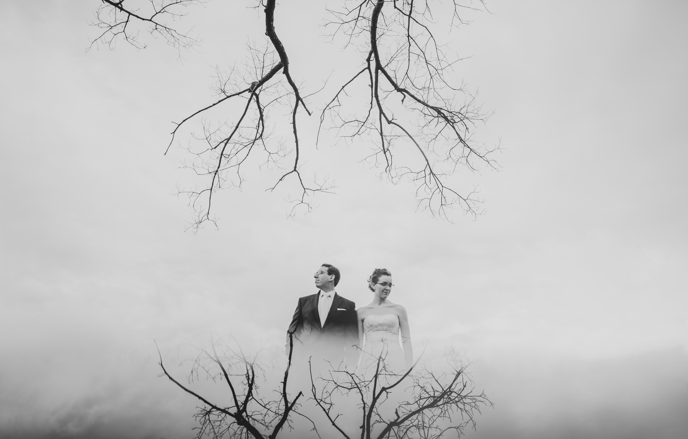 Multiple exposure black and white of couple against winter trees - photo by Sam Hurd - DC