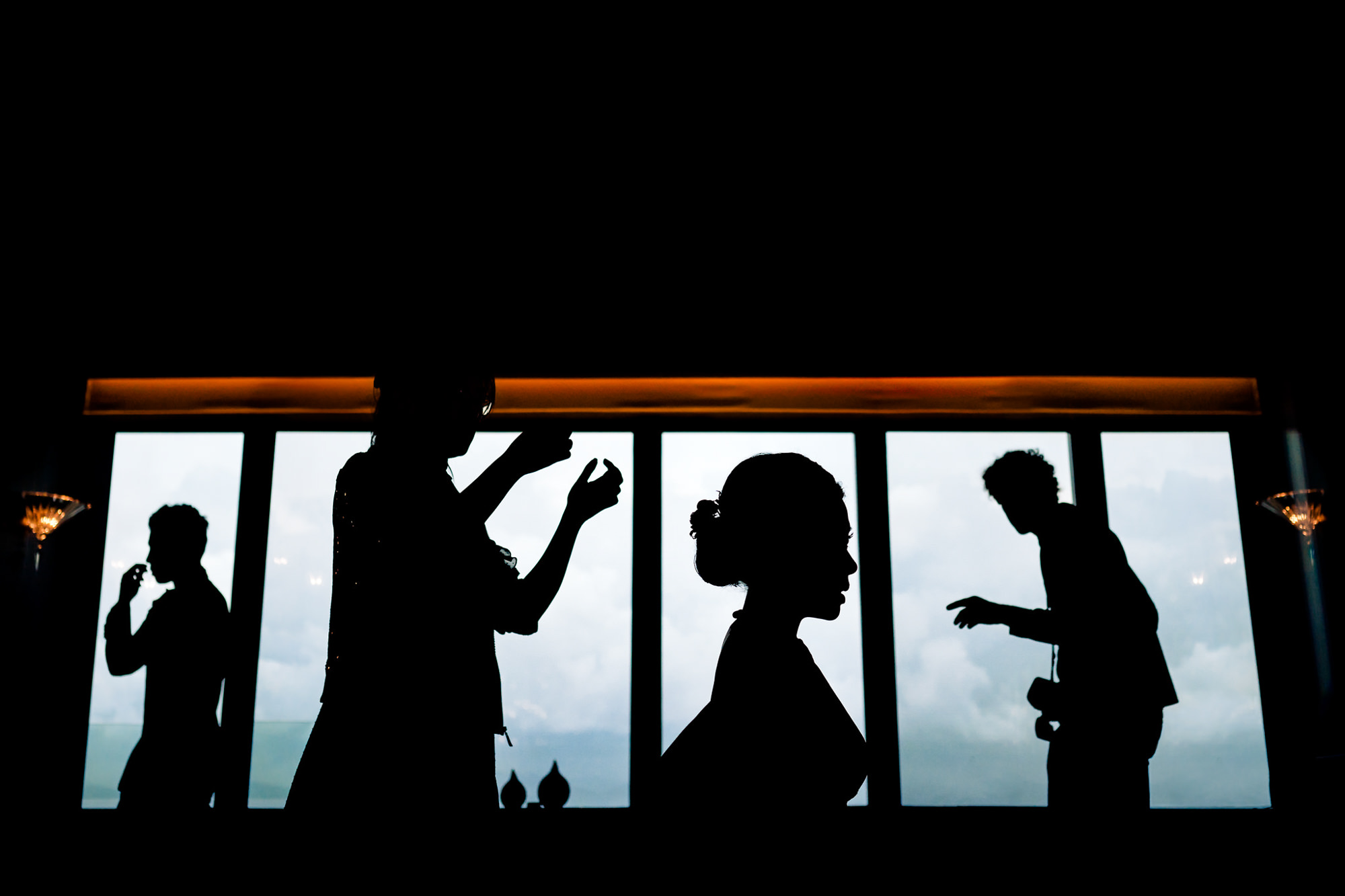 Bride silhouette with others - photo by Two Mann Studios