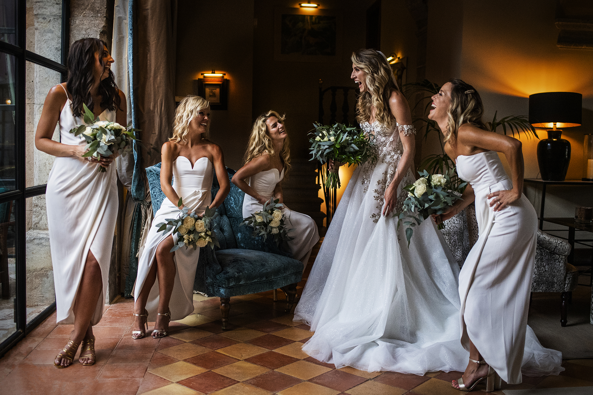 Laughing bridal party portrait - photo by Victor Lax
