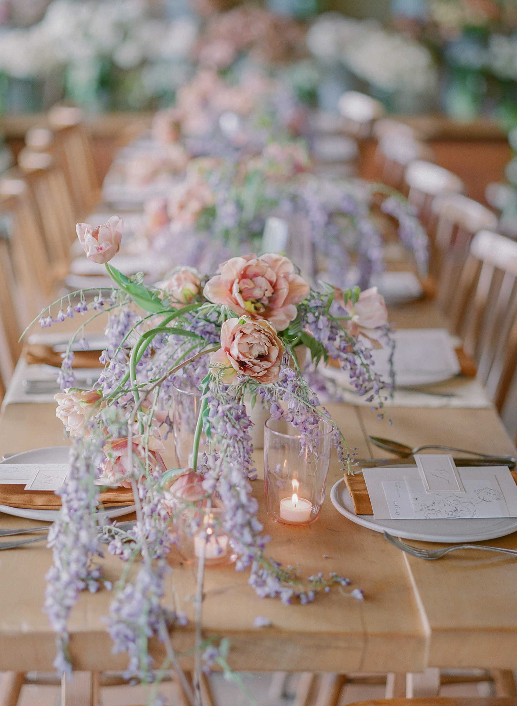 Centerpieces of wisteria and tulips - photo by Corbin Gurkin