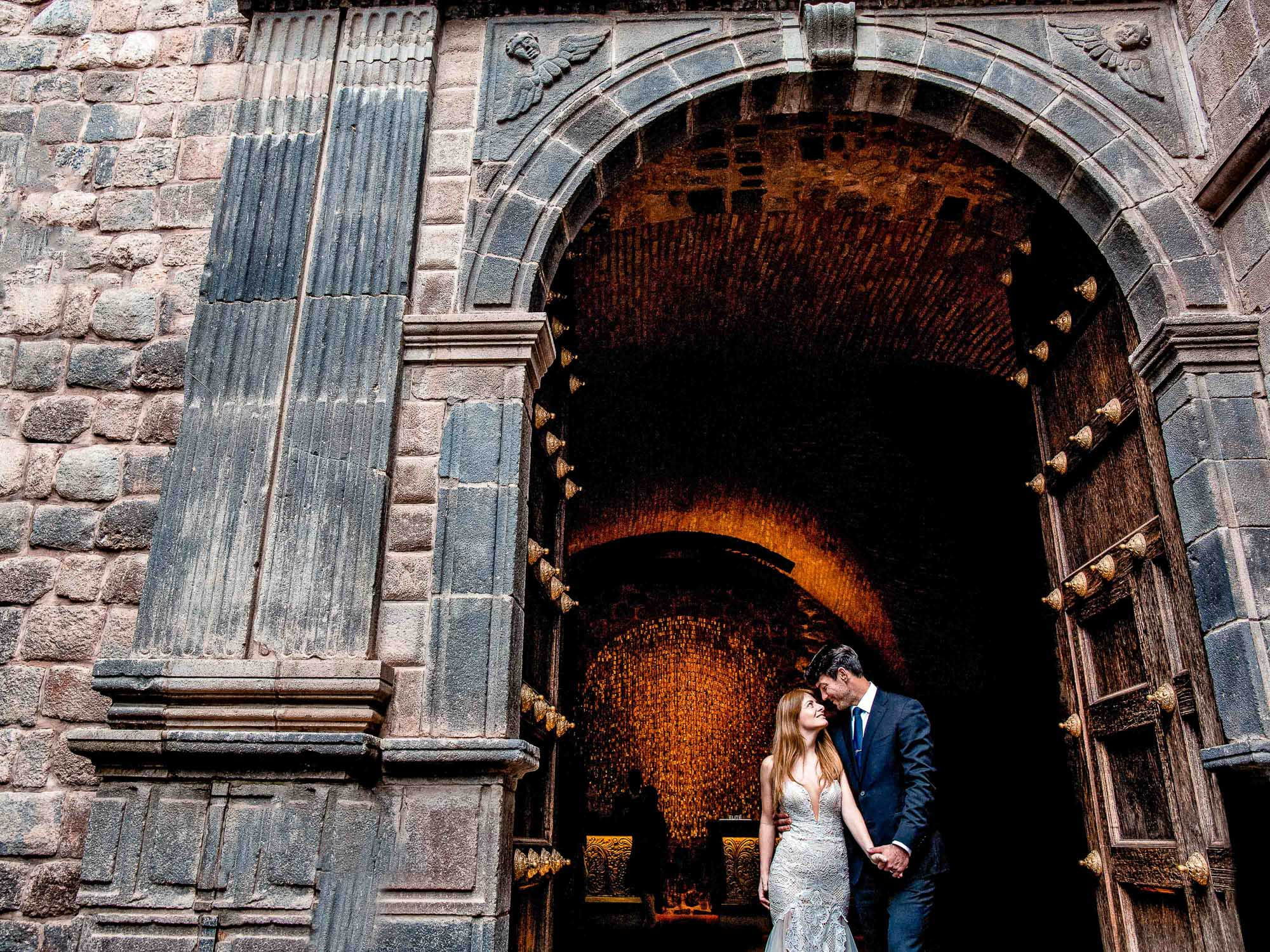 Bride and groom at cathedral doors in Lima Peru- photo by Jos Studios