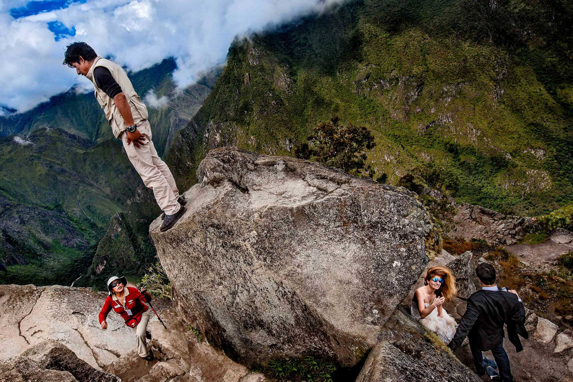 couple hides from hikers on Macchu Picchu - photo by Jos Studios - Portland