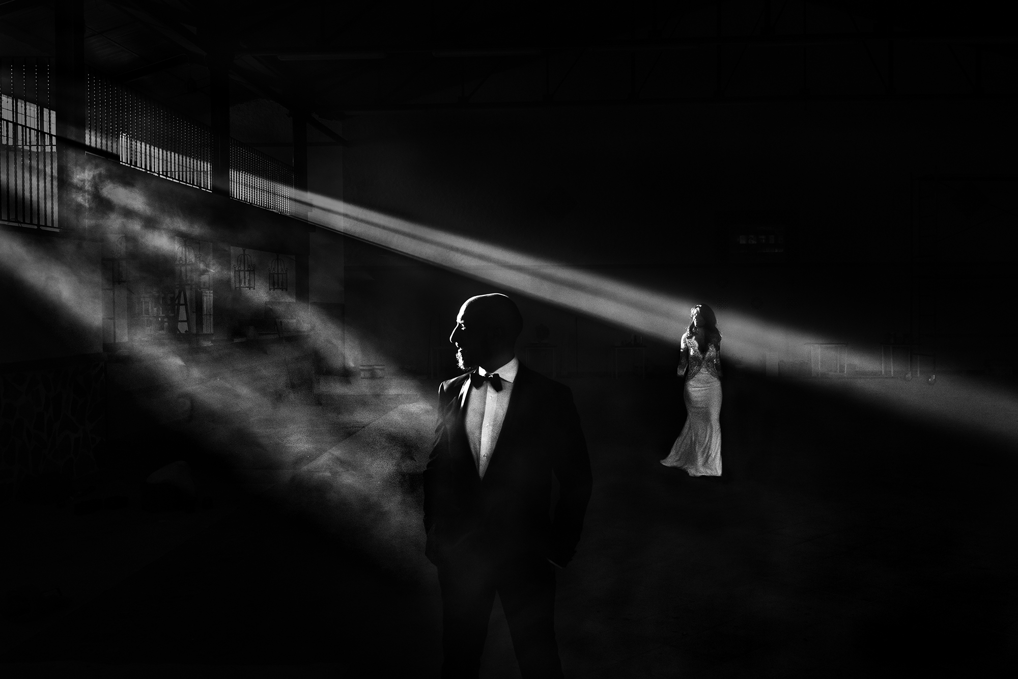 Bride and groom in dramatic light