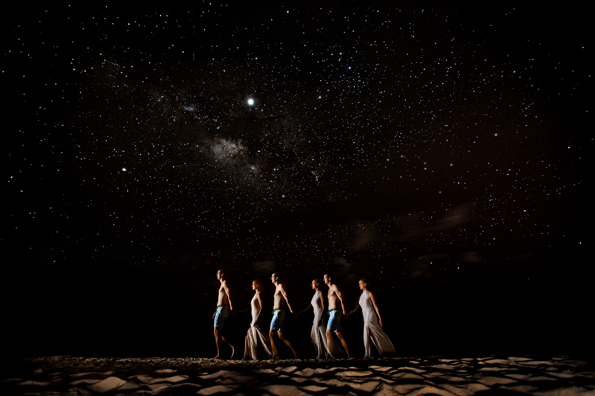 Bride and groomsmen under the stars - photo by Two Mann Studios