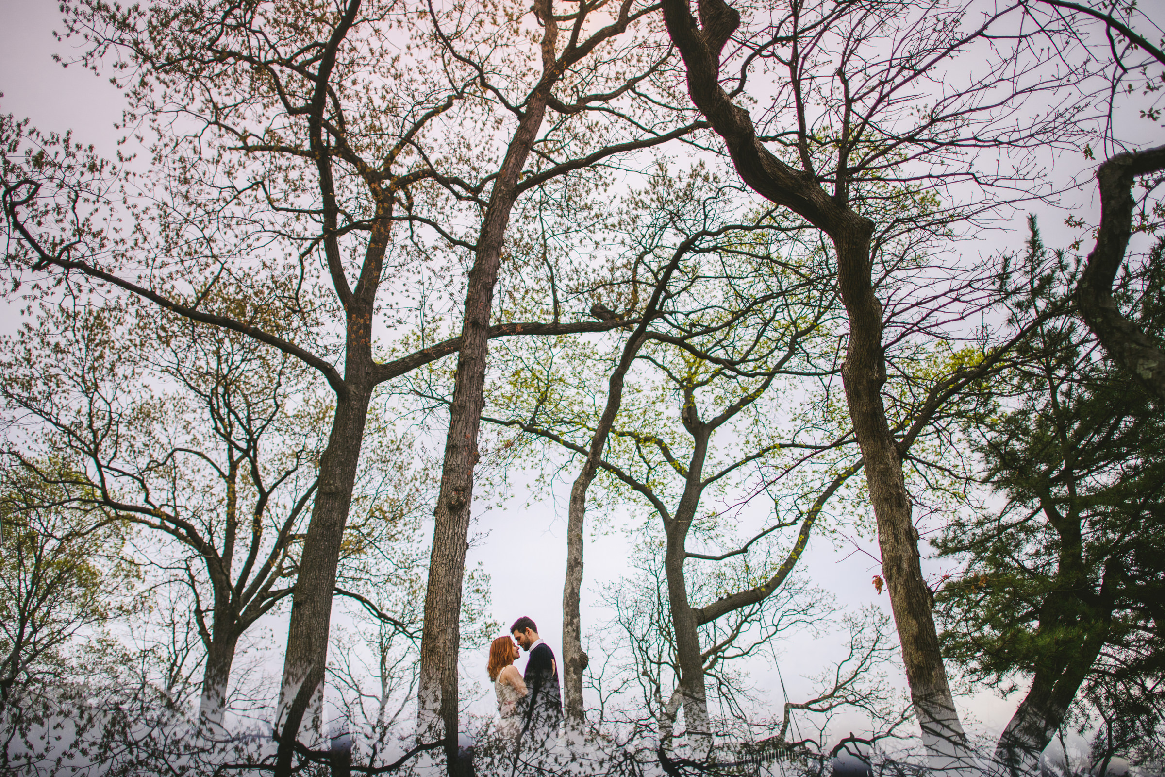 Multiple exposure of couple in trees - photo by Sam Hurd - DC