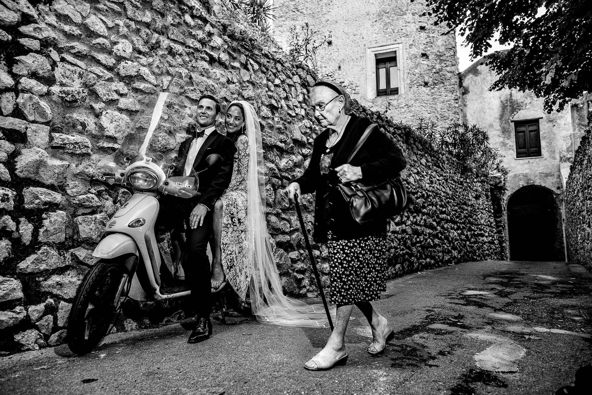 Elderly woman walks by couple on Vespa - photo by Jos Studio - Portland