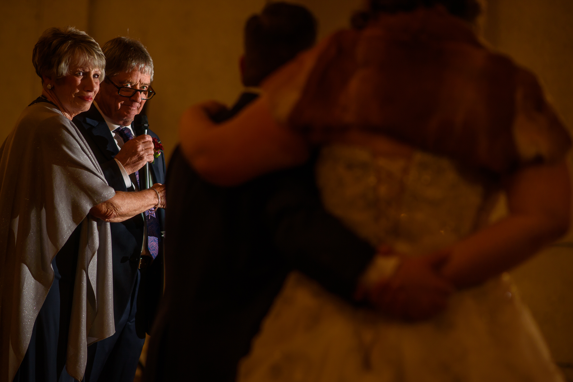 Father looks lovingly at couple during toast photo by Tyler Wirken - Kansas City