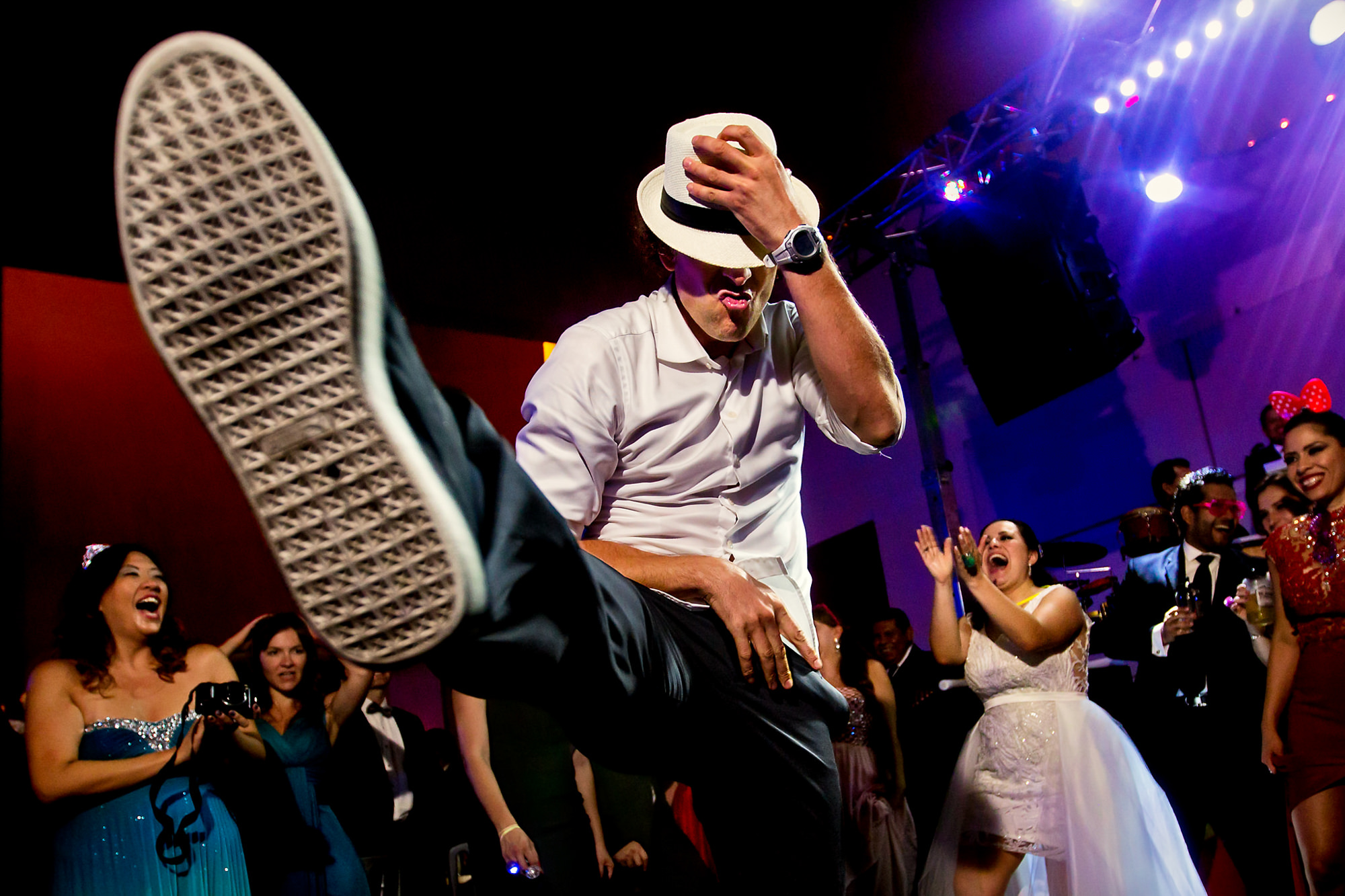 Party guest kicks it up on dance floor - photo by Two Mann Studios