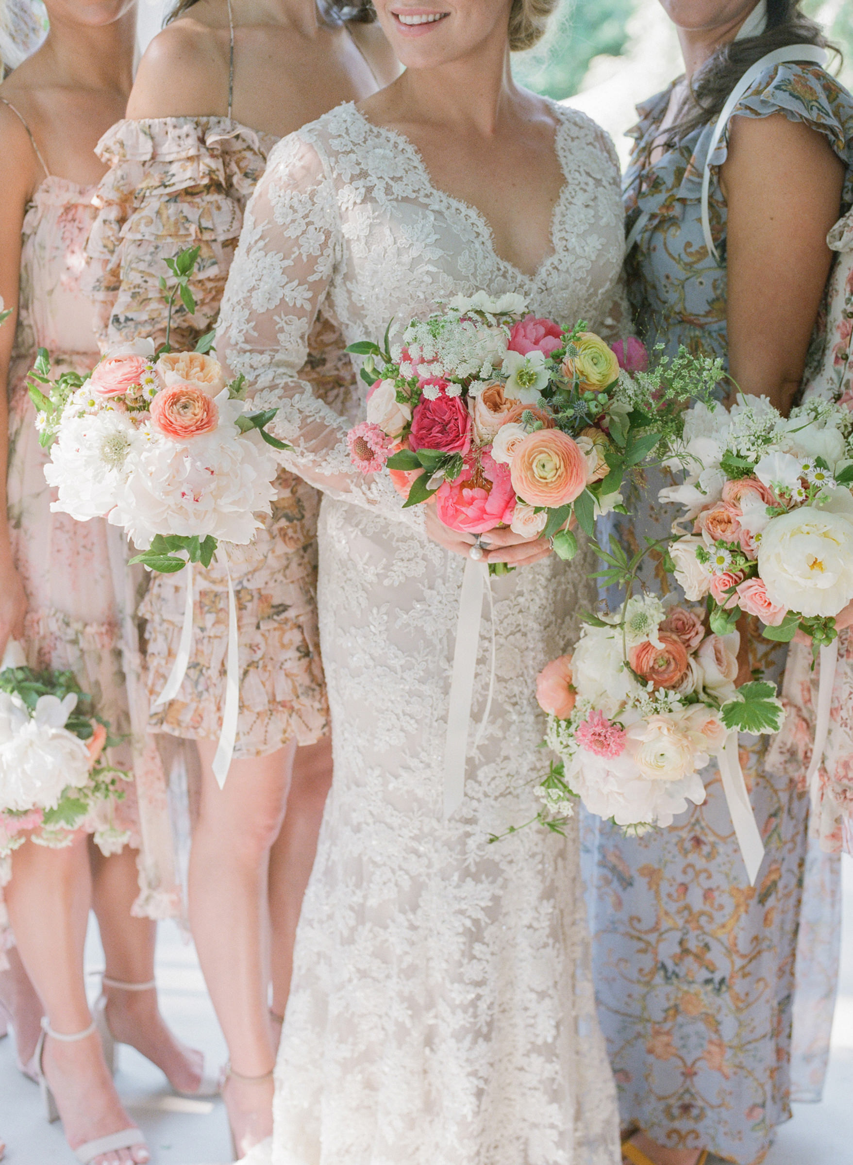 Bride and bridesmaids in lace dresses with spring bouquets  -  photo by Corbin Gurkin