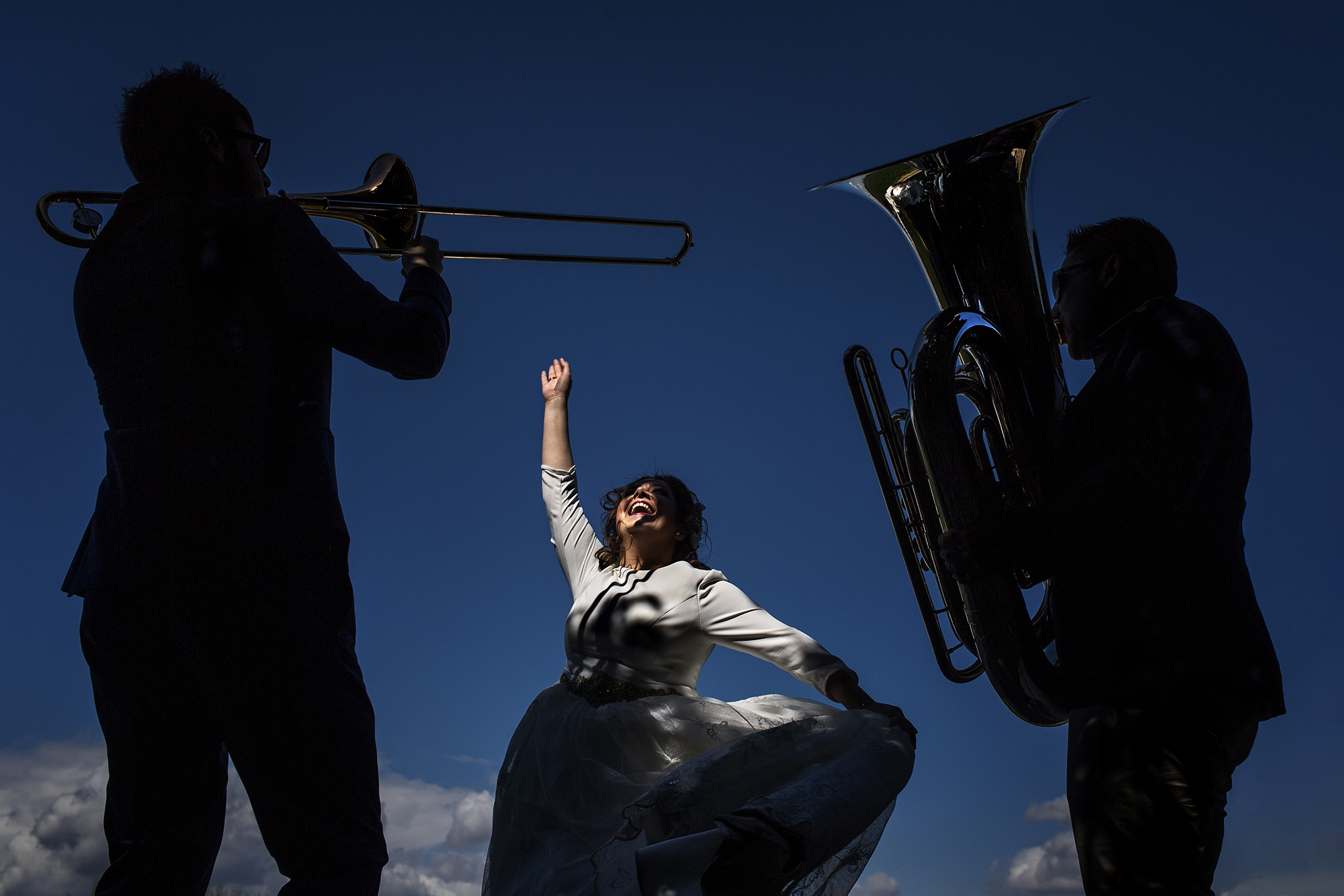 bride dancing with musicians - photo by Victor Lax