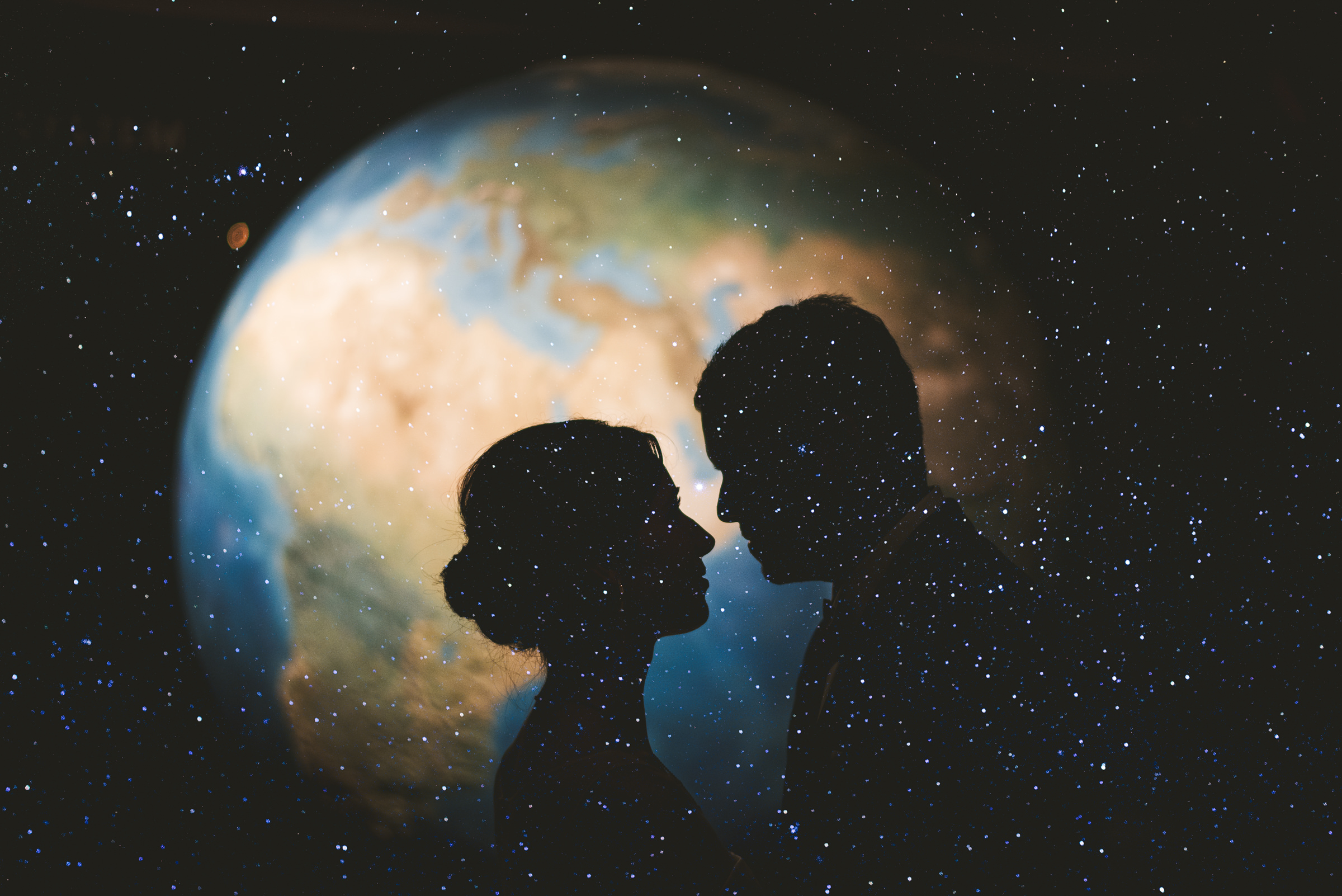 Composite photo of couple in front of the earth  by Sam Hurd - DC