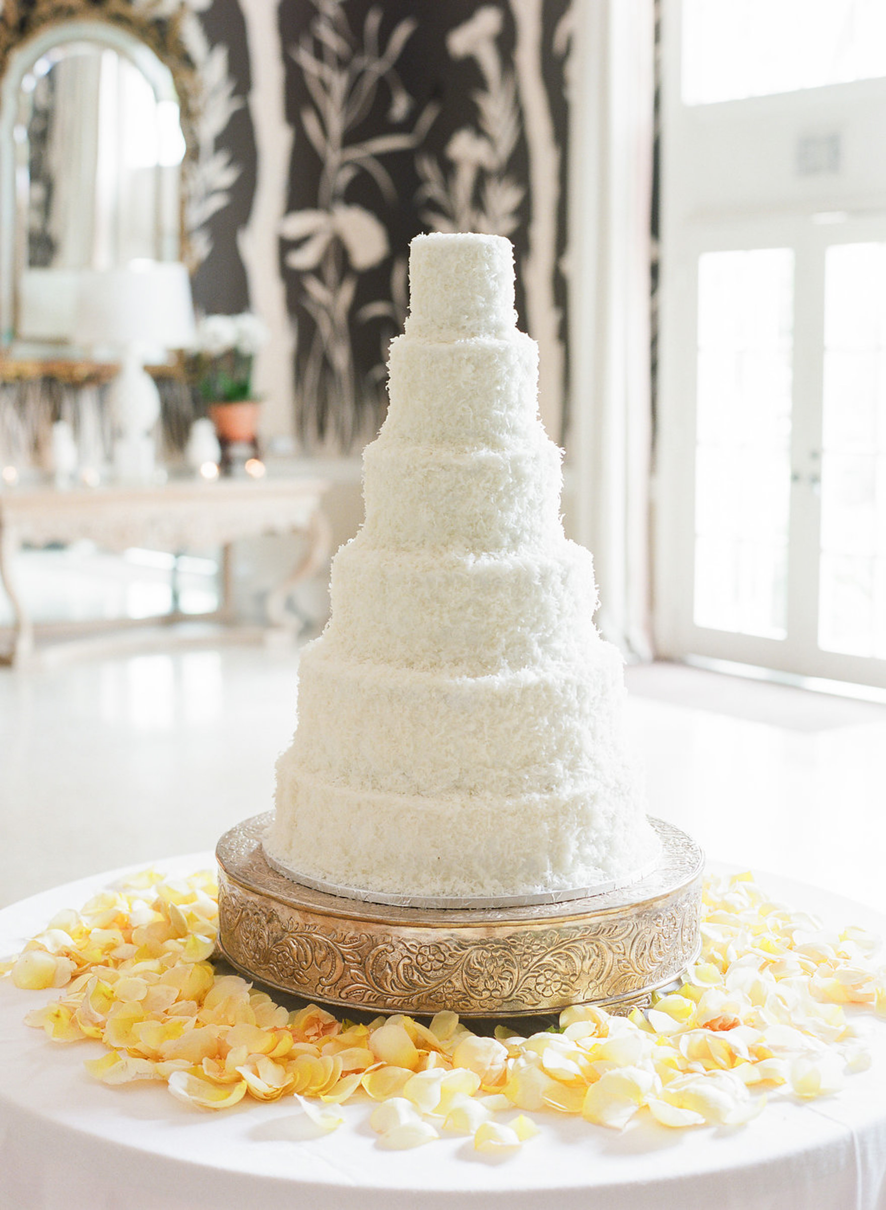 Six tiered cocunut wedding cake - photo by Corbin Gurkin