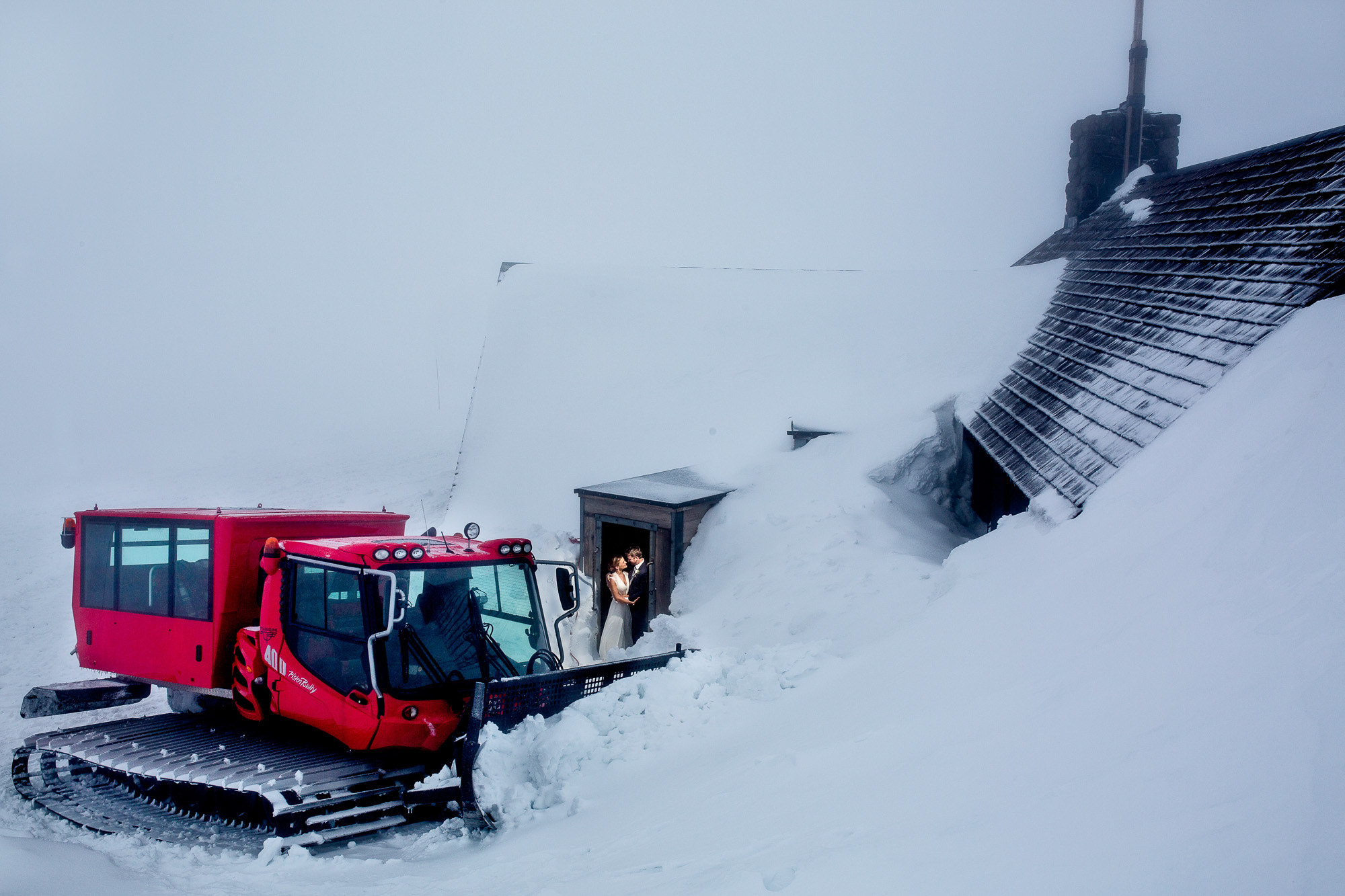 Snow plow rescue for couple at ski lodge - photo by Jos Studios