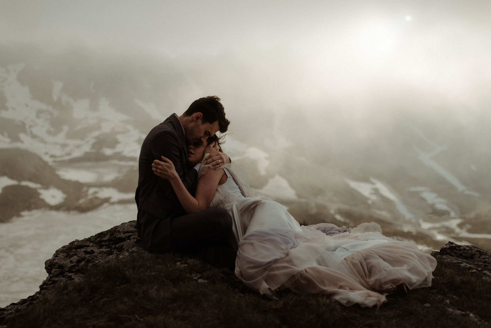 Epic snowy mountain landscape portrait of bride and groom - photo by the Kitcheners - Scotland