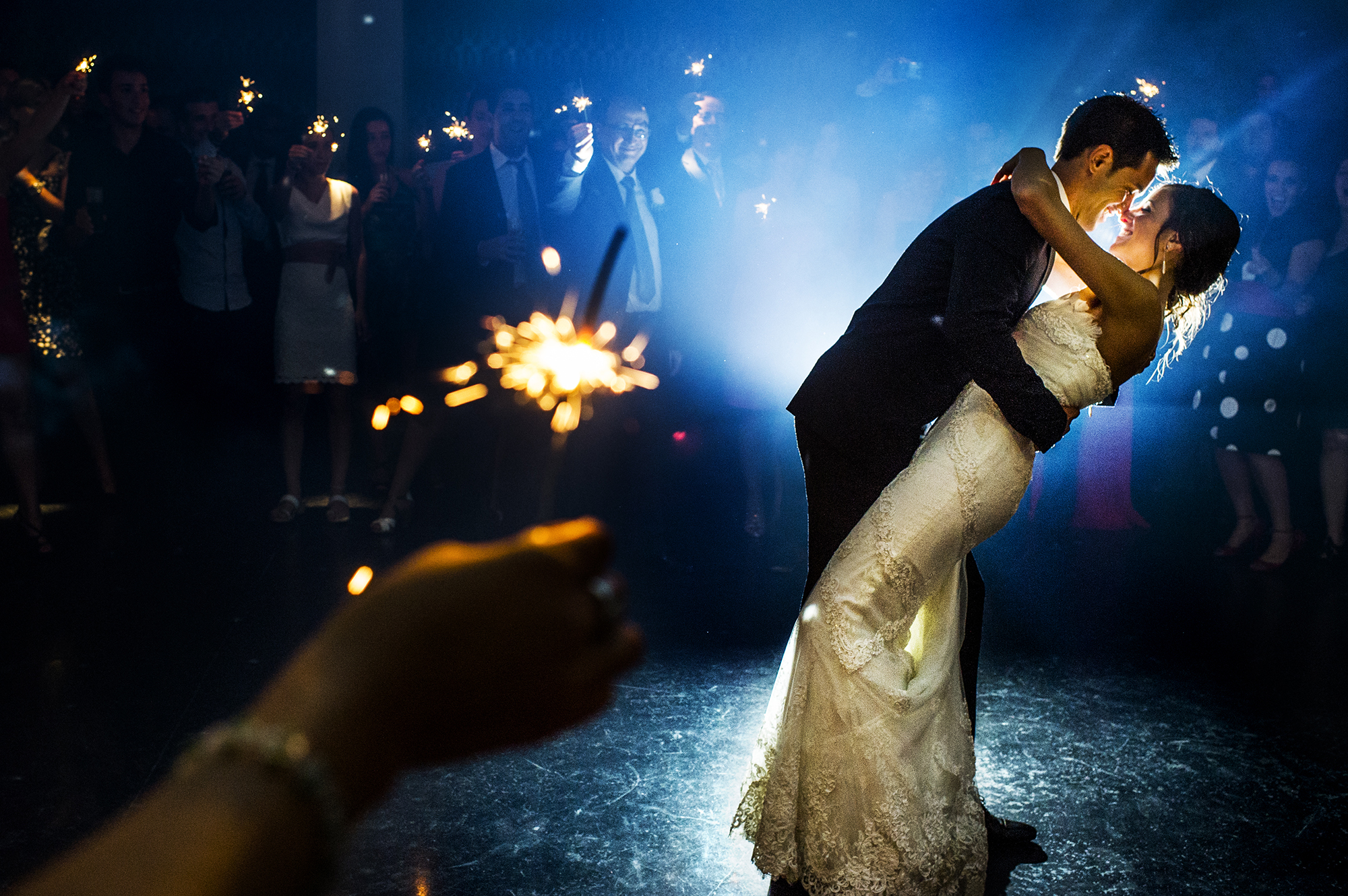 Couple surrounded by sparklers - photo by Victor Lax