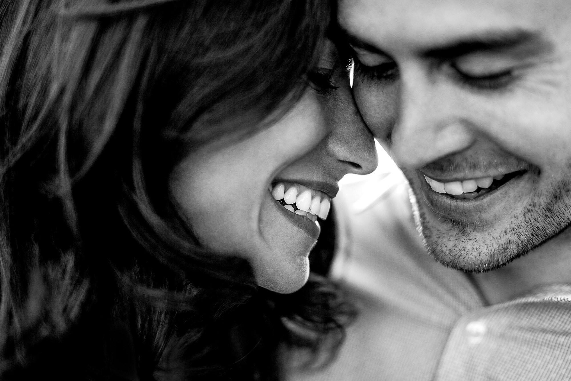 Sweet smiling couple portrait by JOS Studios