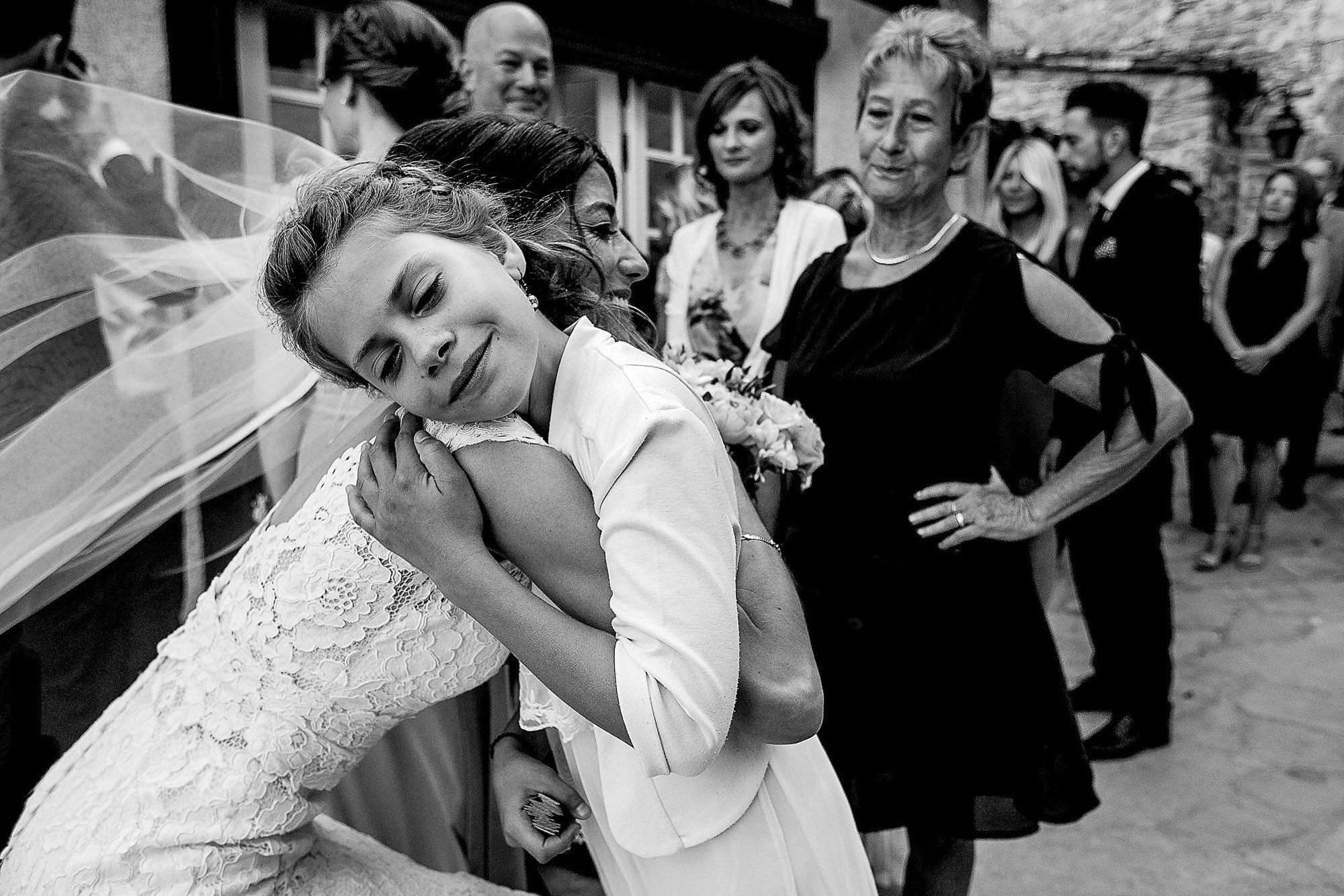 Bride embracing child photo by JOS Studios