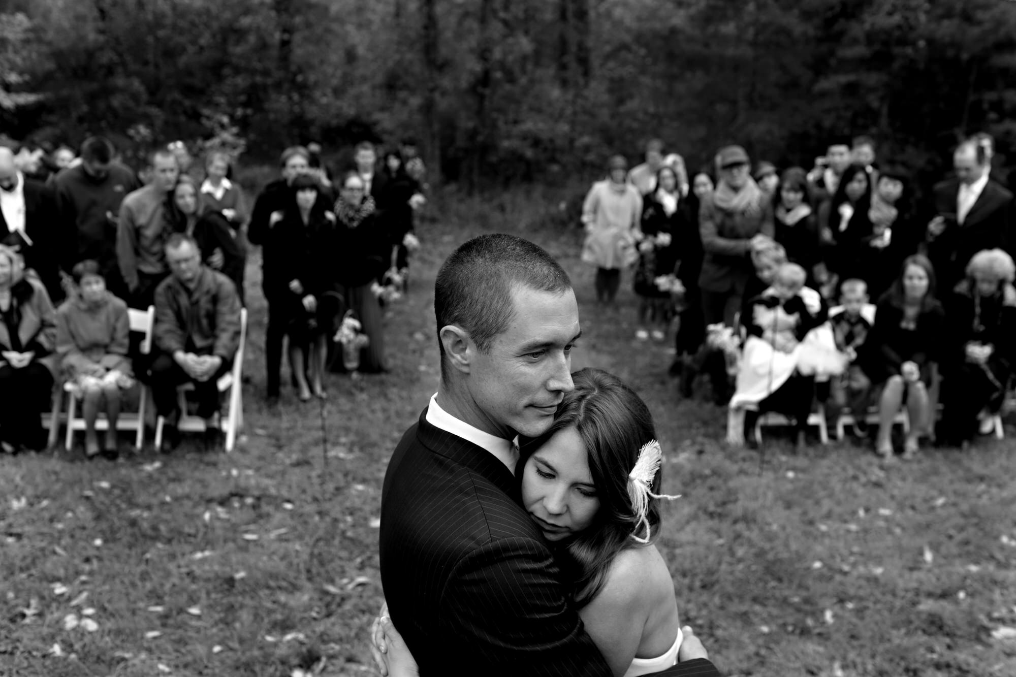 Intimate moment between bride and groom at ceremony  - photo by Tyler Wirken