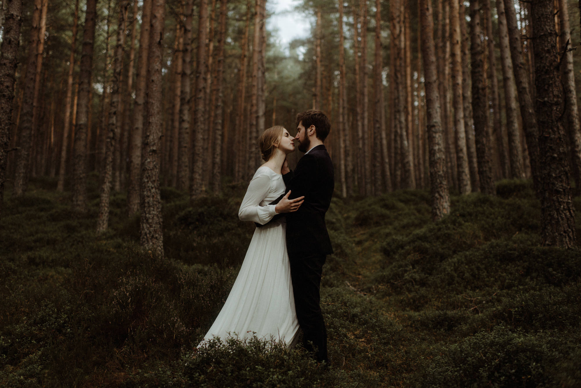 Couple kiss in forest - photo by Dylan Kitchener - Scotland