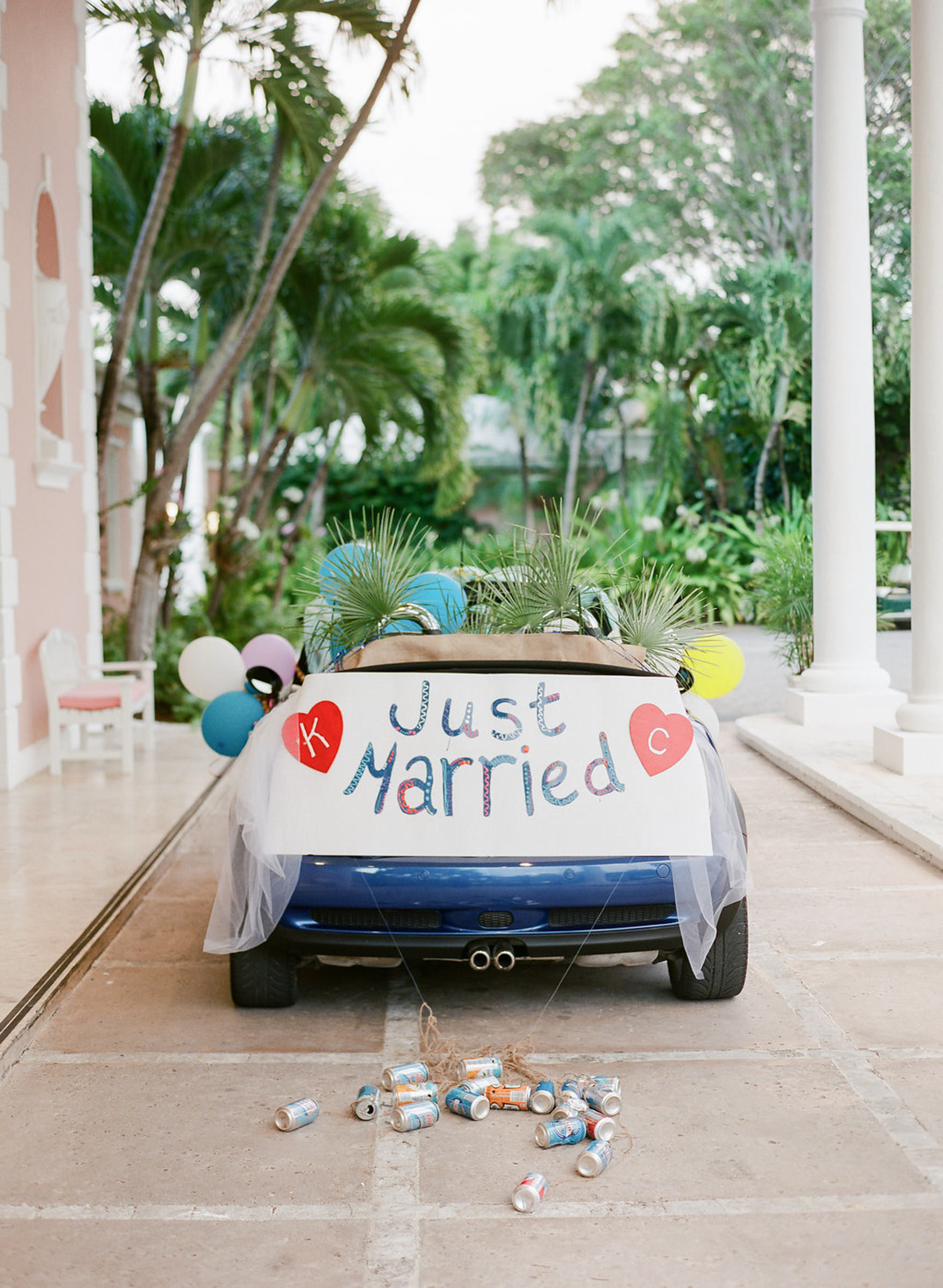 Fun just married sign with balloons on convertible - photo by Corbin Gurkin