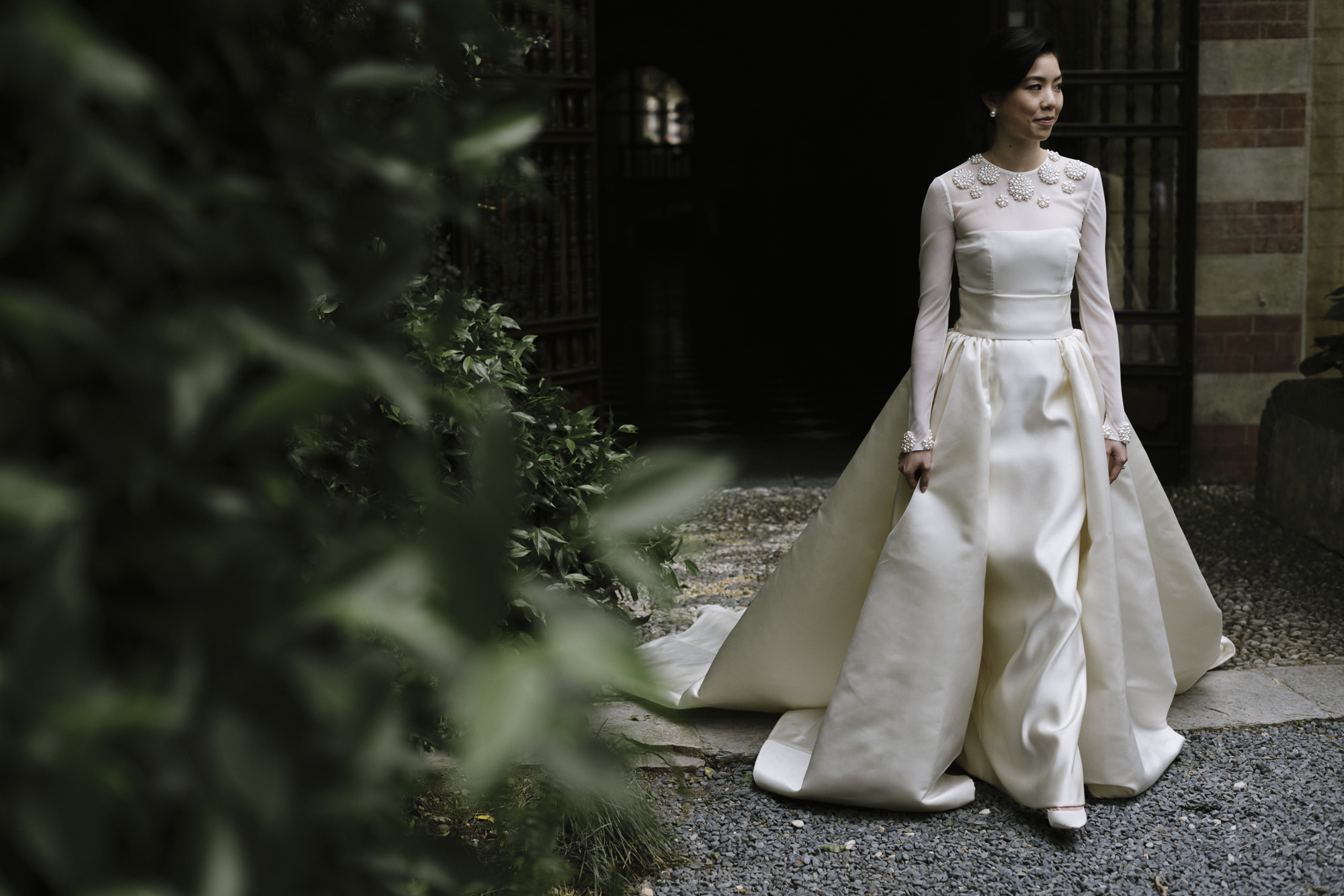 Asian bride in elegant long-sleeved wedding gown, by Thierry Joubert