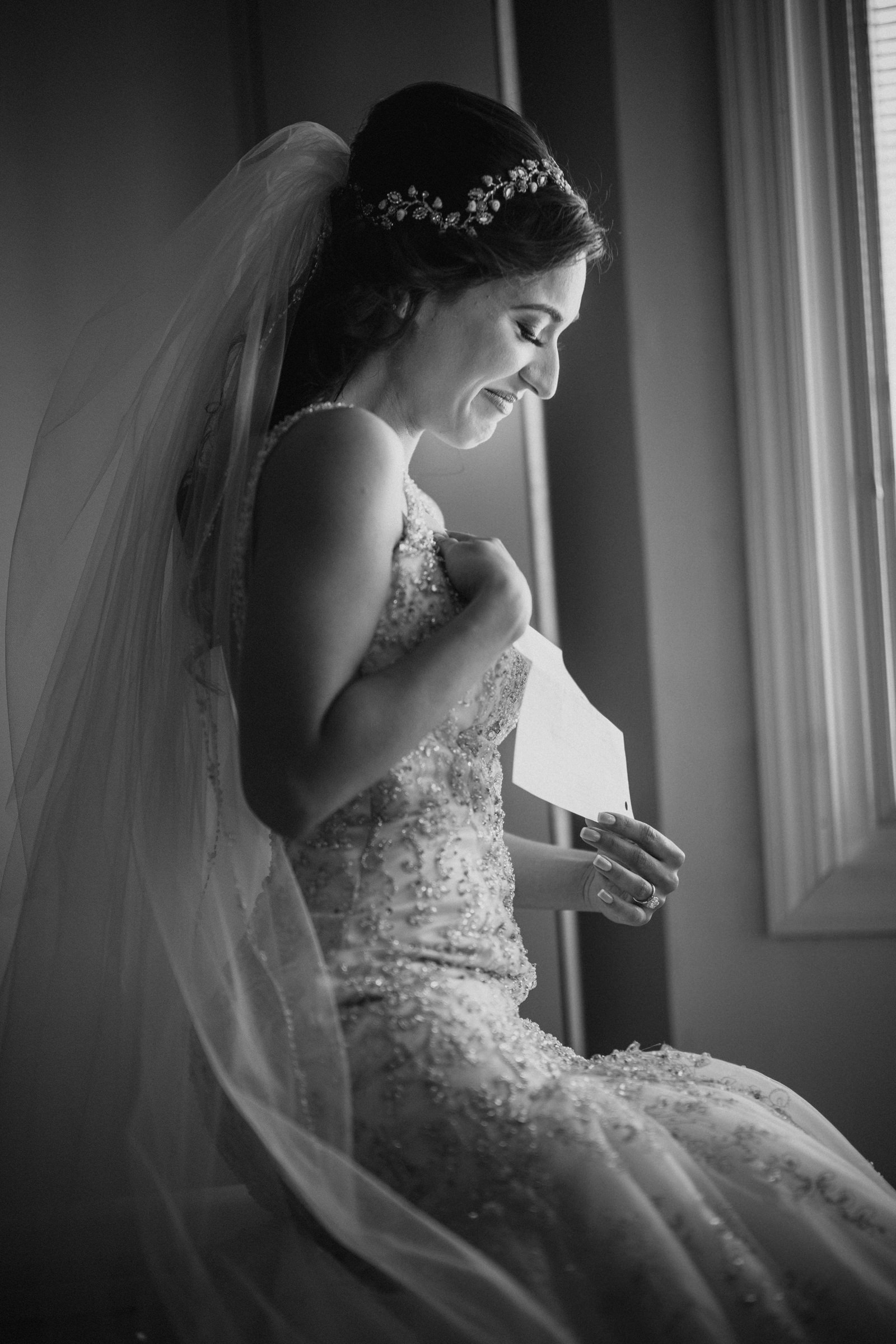 Emotional bride reads groom letter - Photo by Susan Stripling Photography