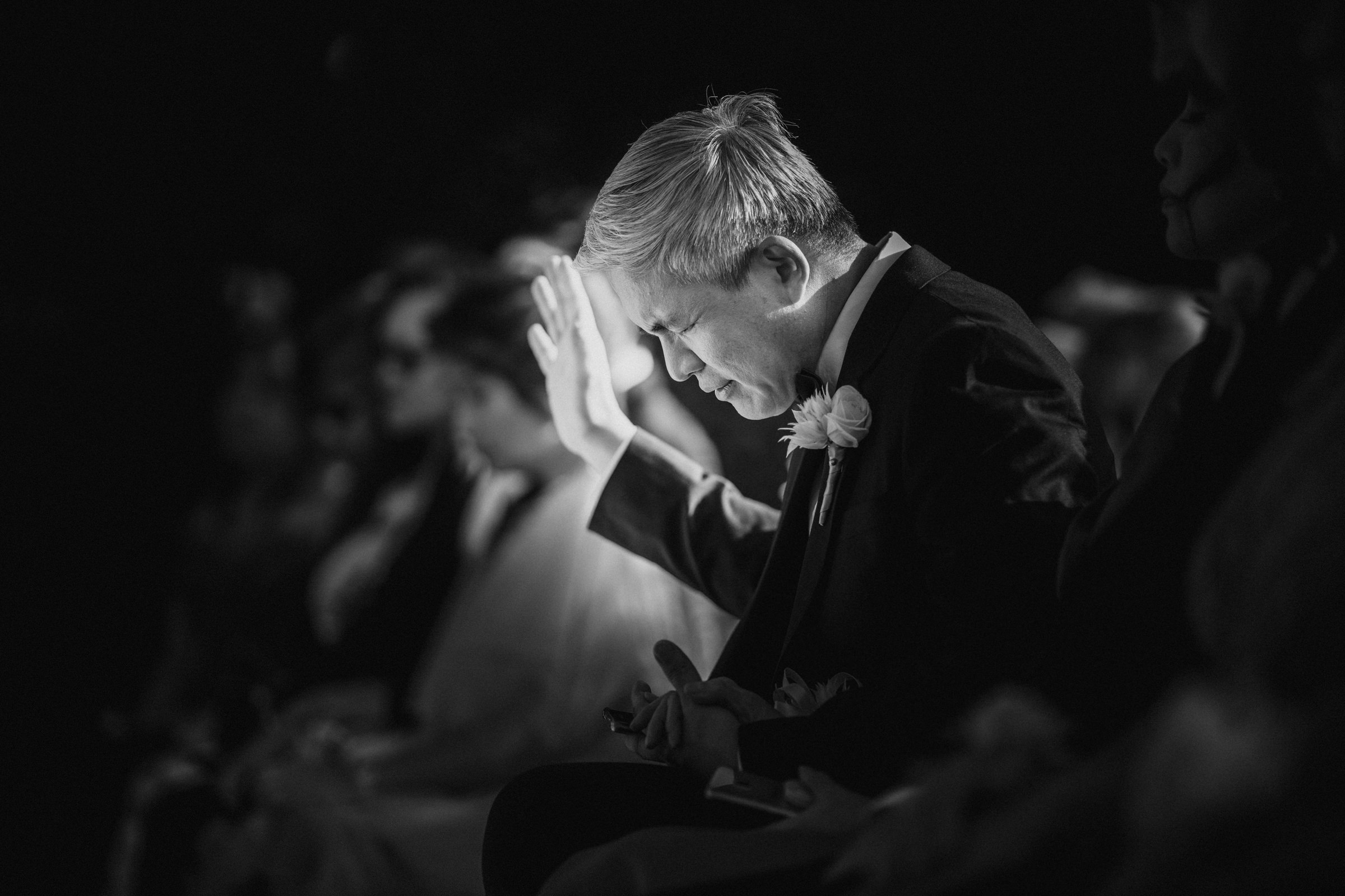 Dad praying at ceremony - Photo by Susan Stripling Photography