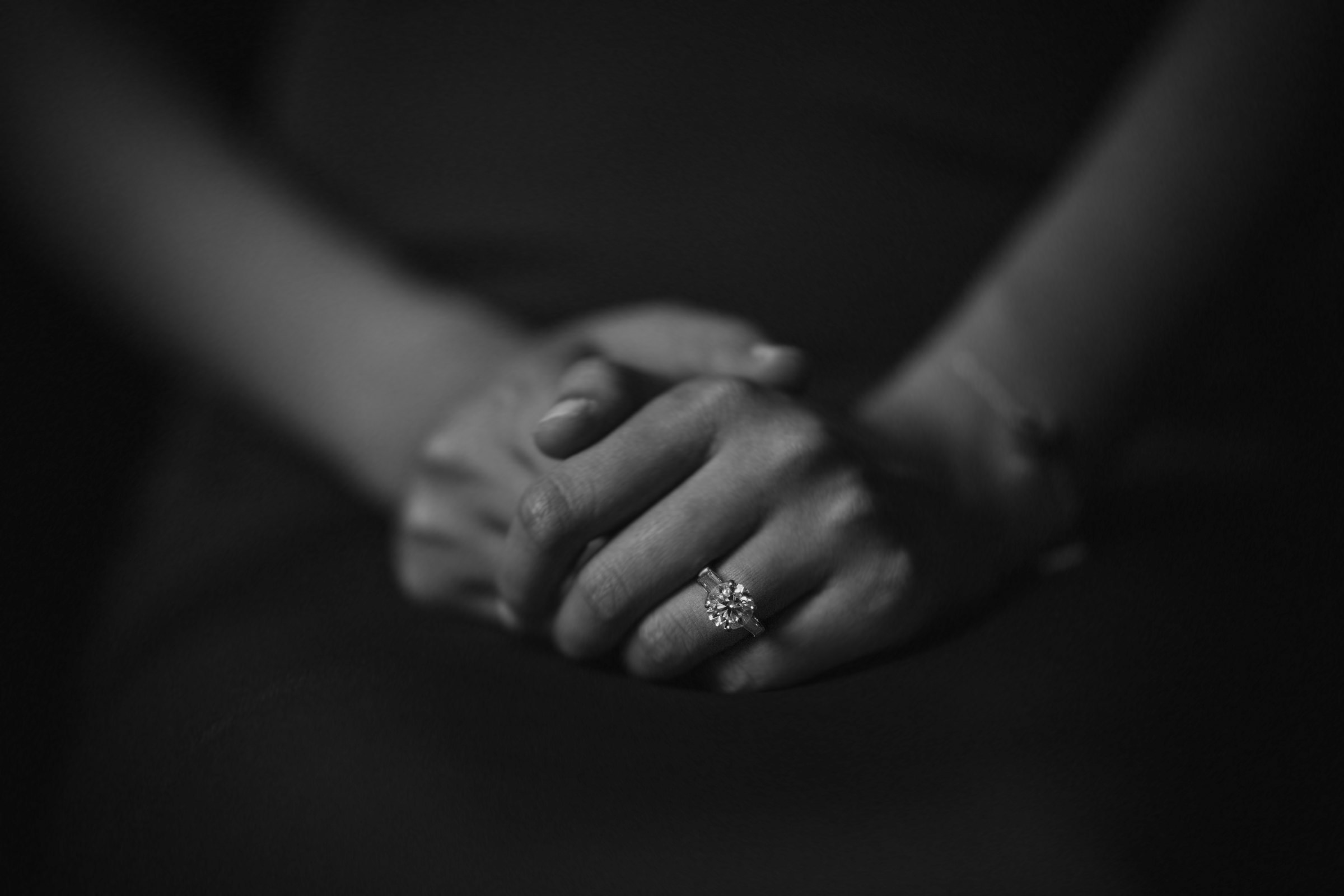 Clasped hands with engagement diamond - Photo by Susan Stripling Photography