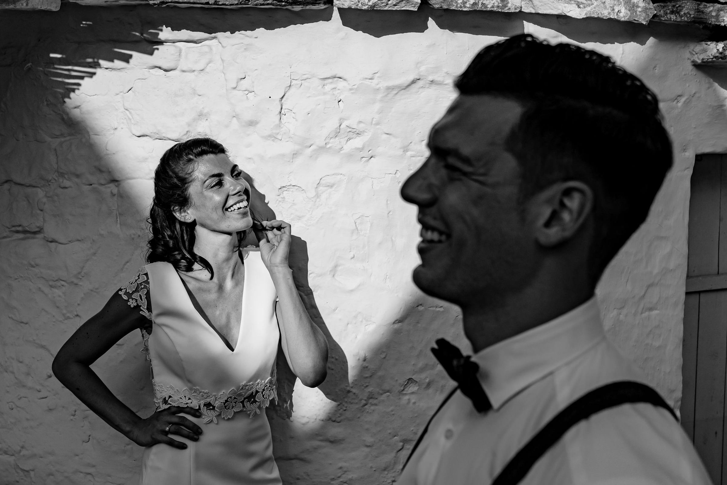 Black and white portrait of bride and groom smiling, photo by Philippe Swiggers