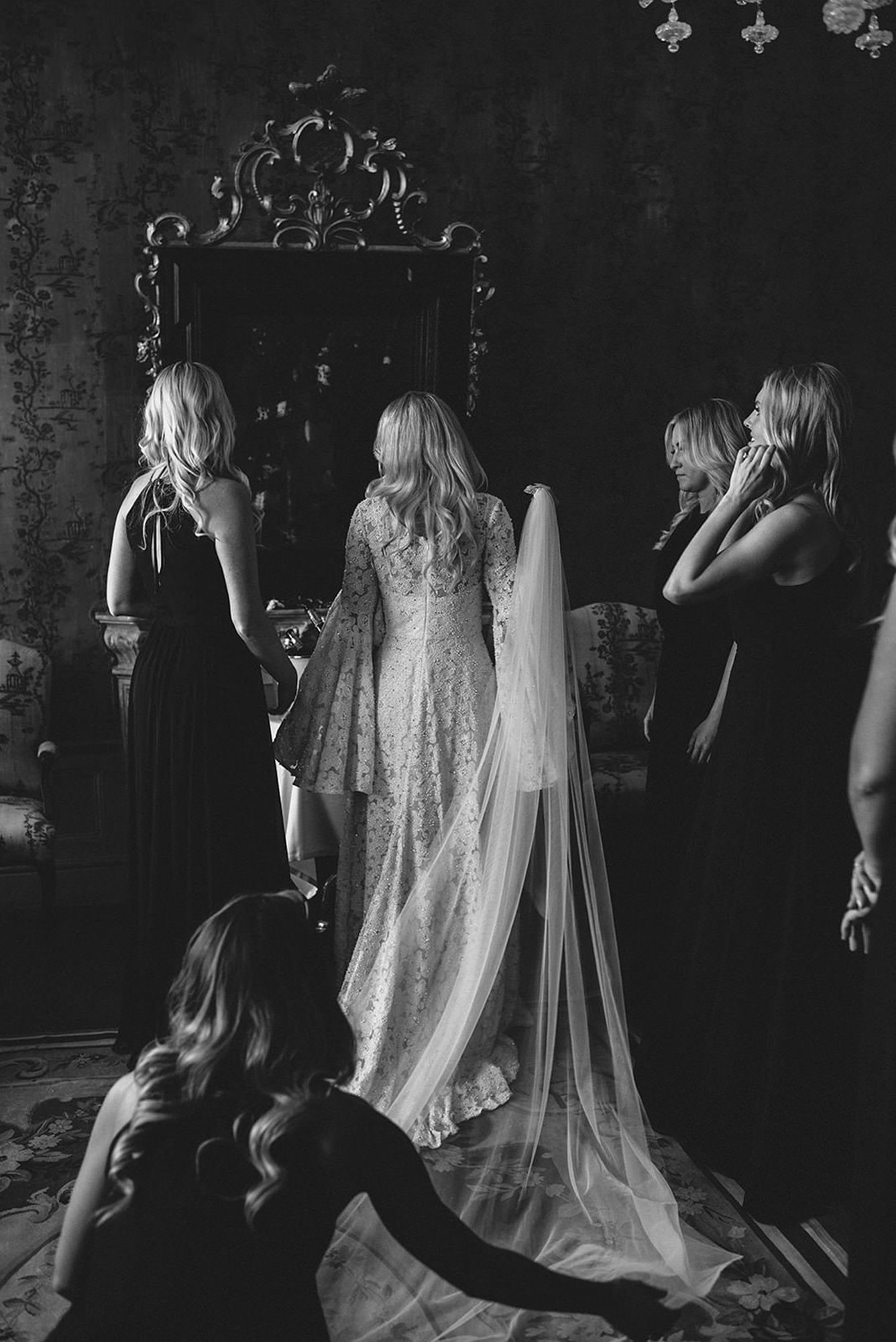 Black and white of bride getting ready with bridesmaids, by Thierry Joubert