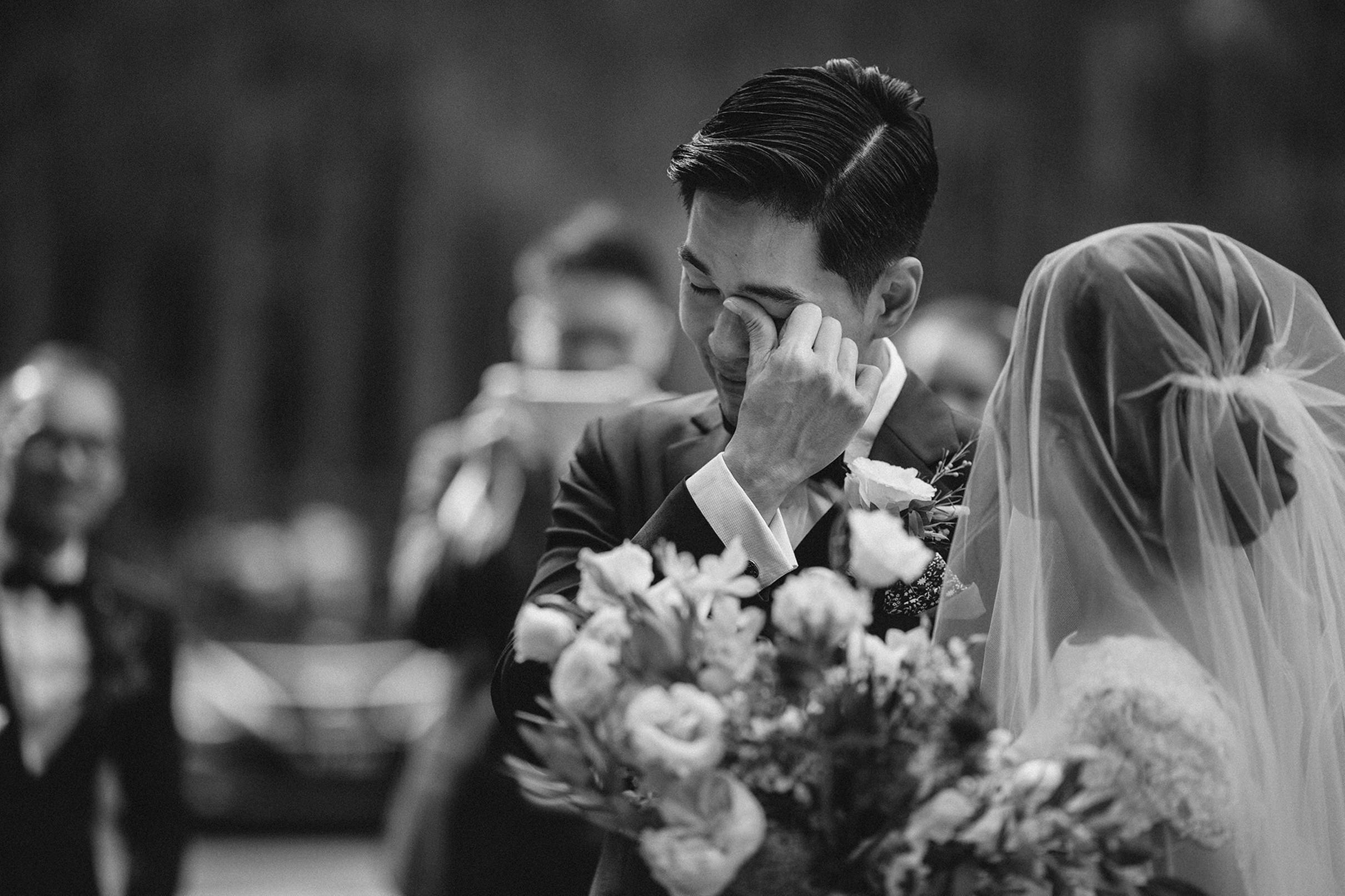Groom tearing up at ceremony - Photo by MunKeat Photography Studio