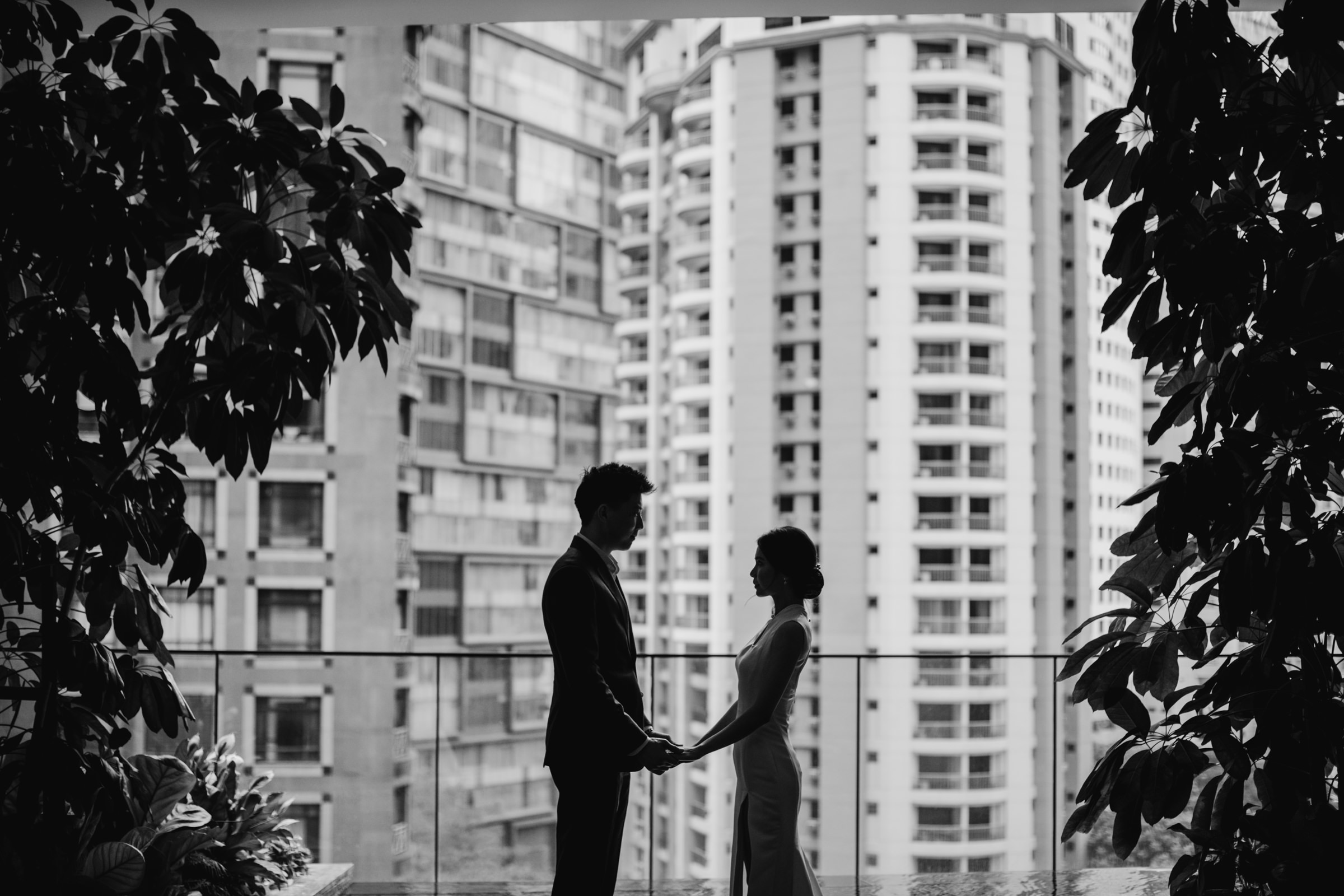 Couple silhouette against skyscrapers - Photo by MunKeat Photography Studio