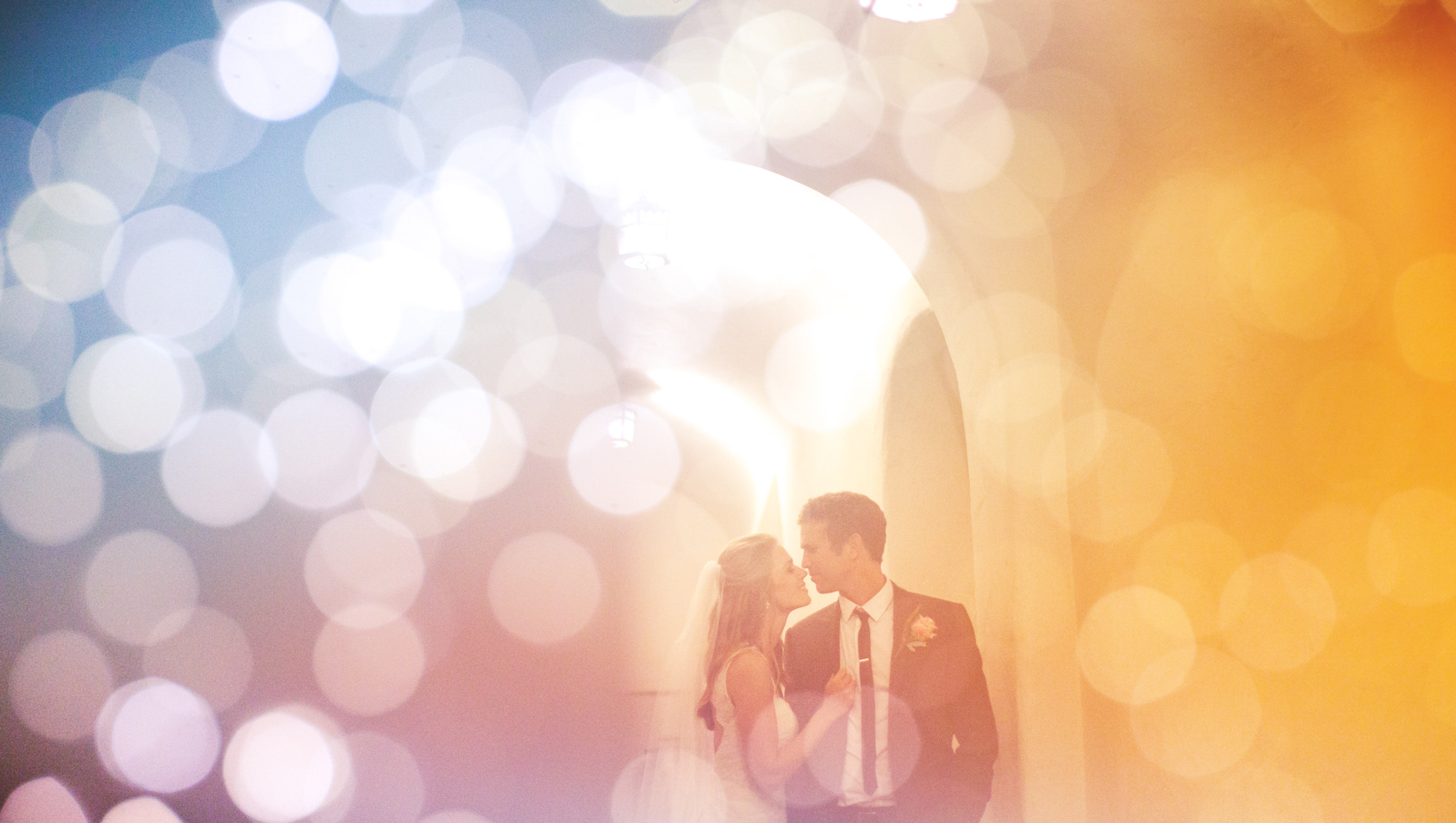 Multiple exposure of a bride and groom portrait in pastel, by Jeff Newsom