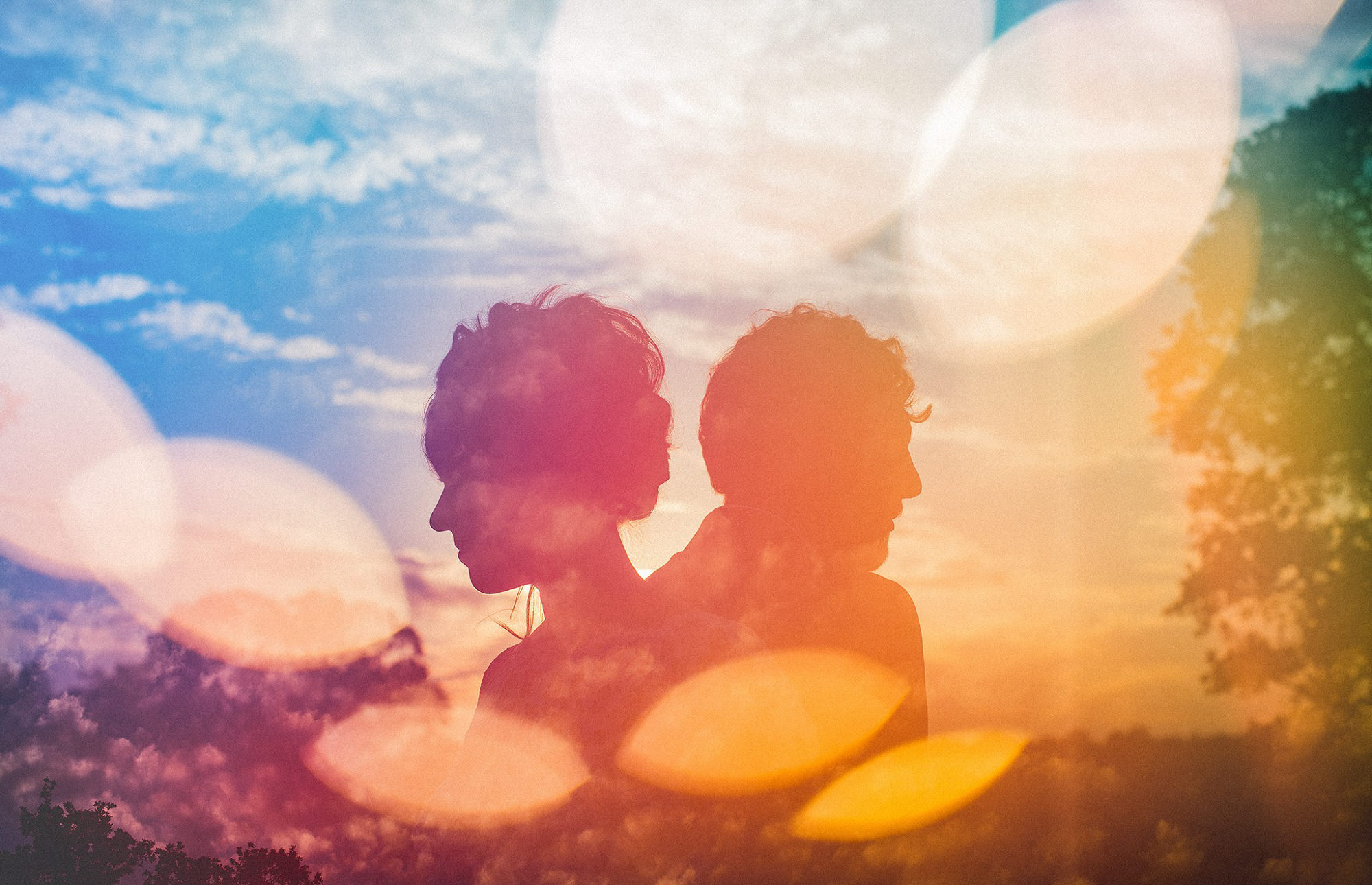 Colorful multiple exposure of couple silhouette, by Jeff Newsom