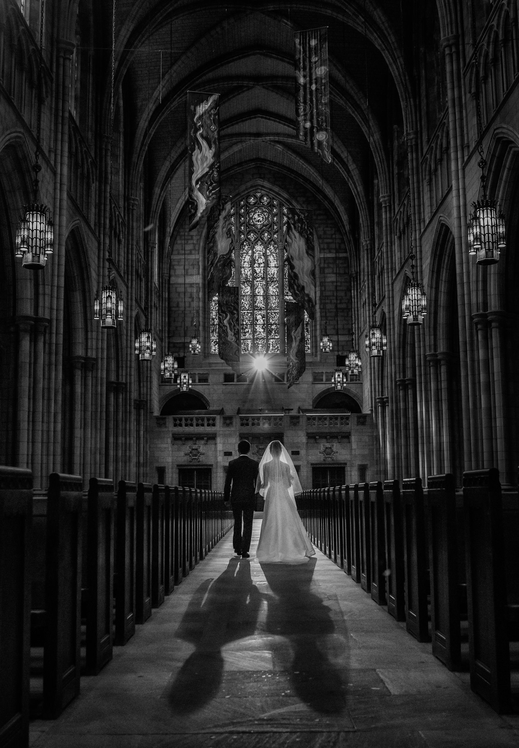Bride and groom walk down aisle of cathedral - Photo by Susan Stripling Photography