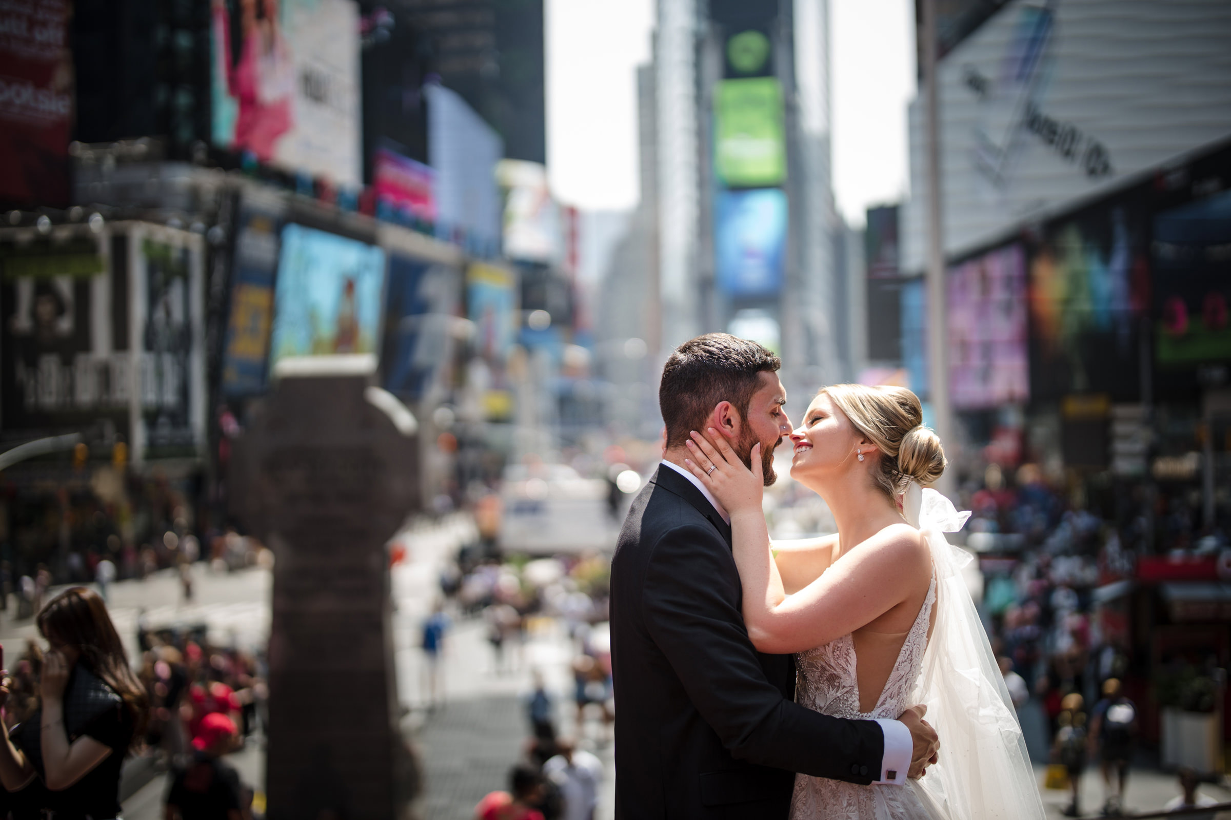 Bride and groom against times square NY - Photo by Susan Stripling Photography